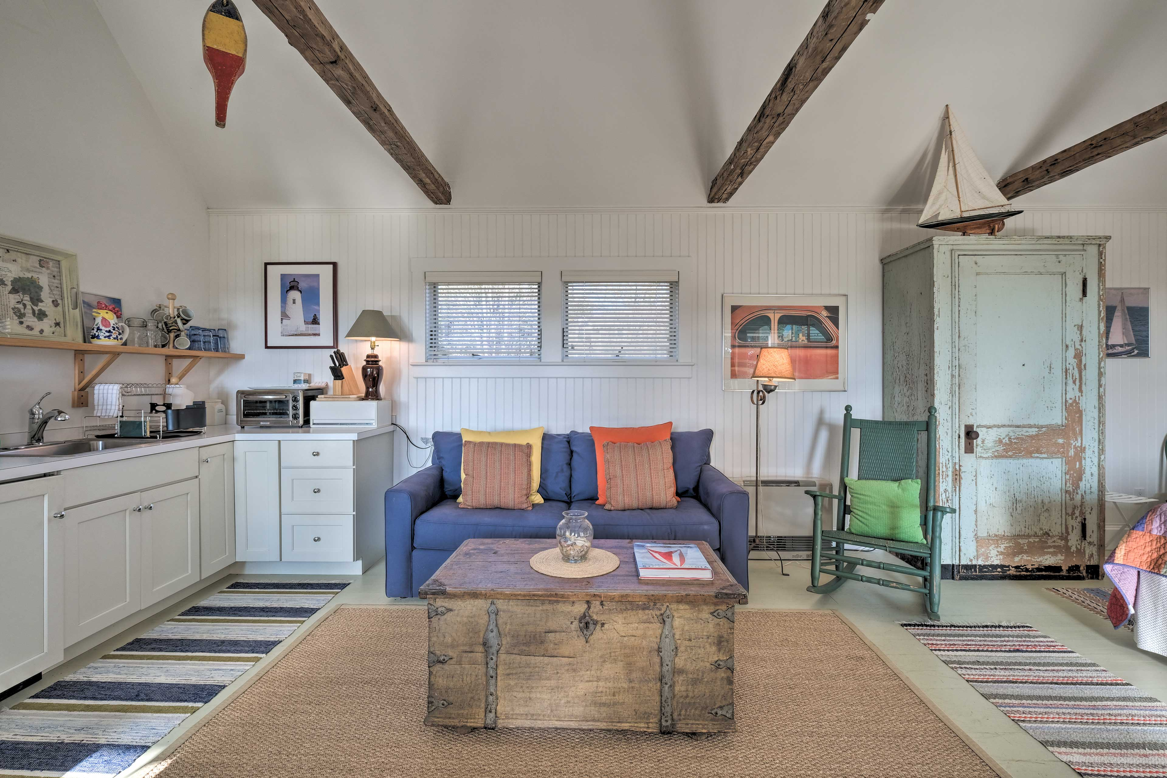 Exposed wood beams and a clean white interior set a relaxing atmosphere.