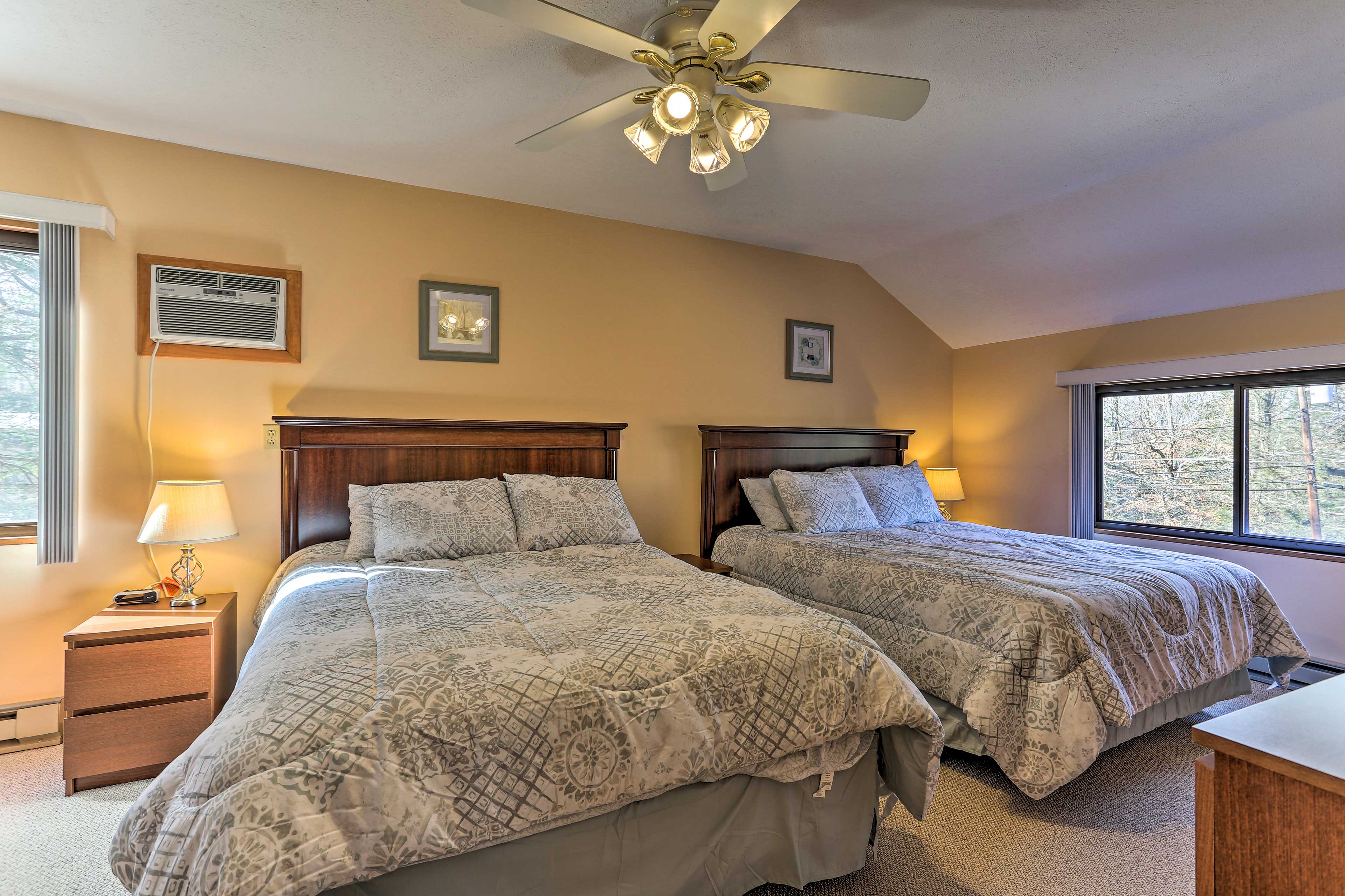 The third bedroom is complete with 2 queen-sized beds.