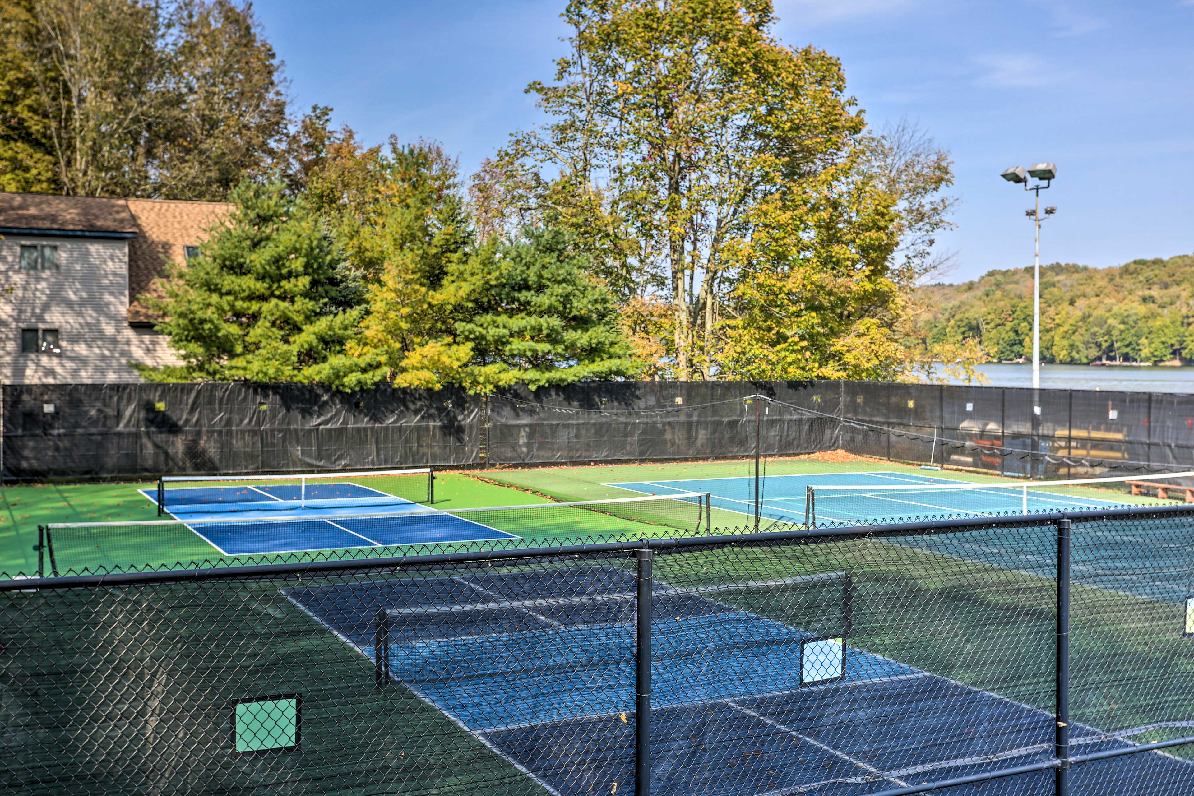 Challenge your next competitor to a match of tennis on the courts.