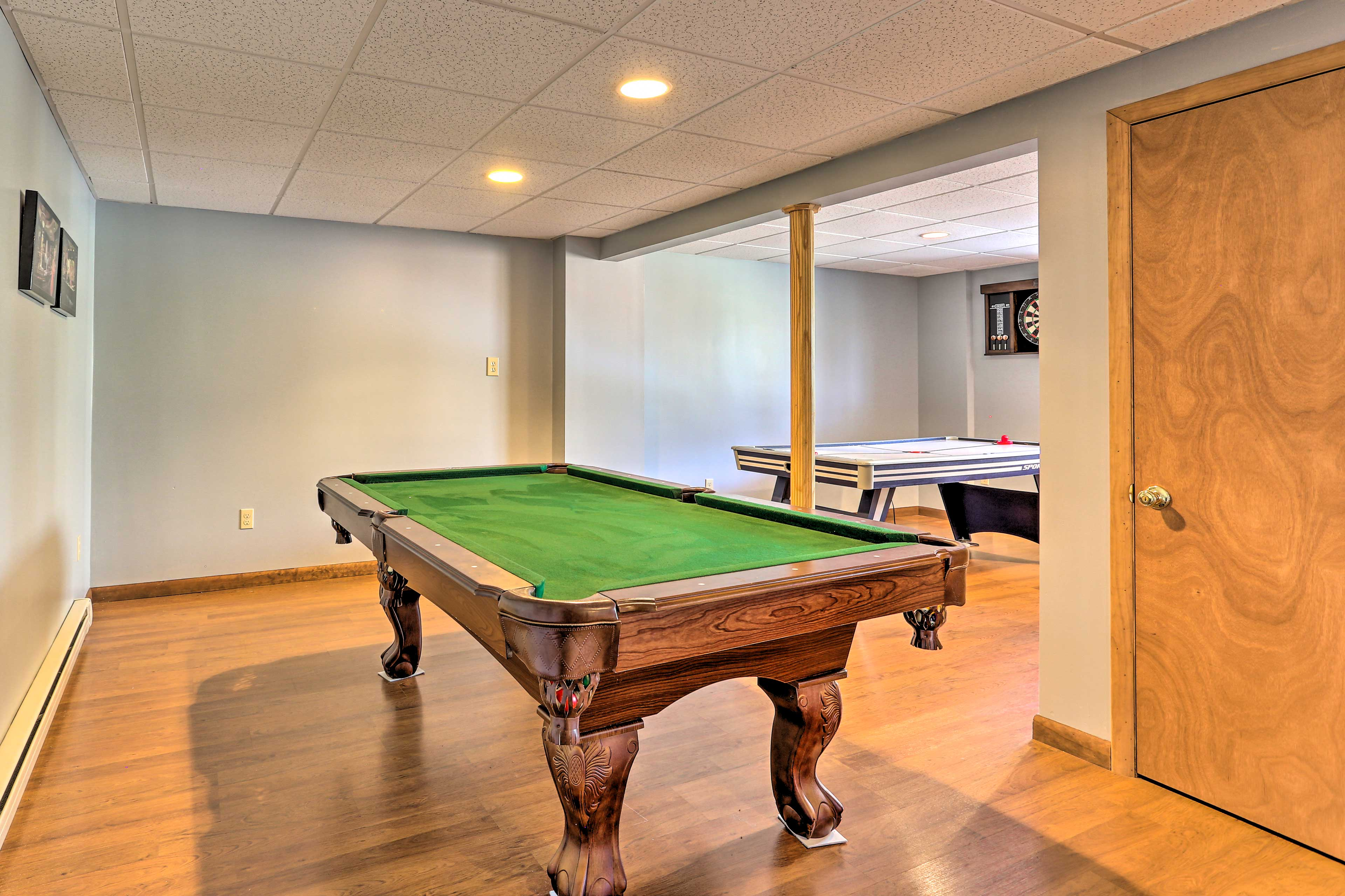 Downstairs in the game room you'll find a pool table and an air hockey table.