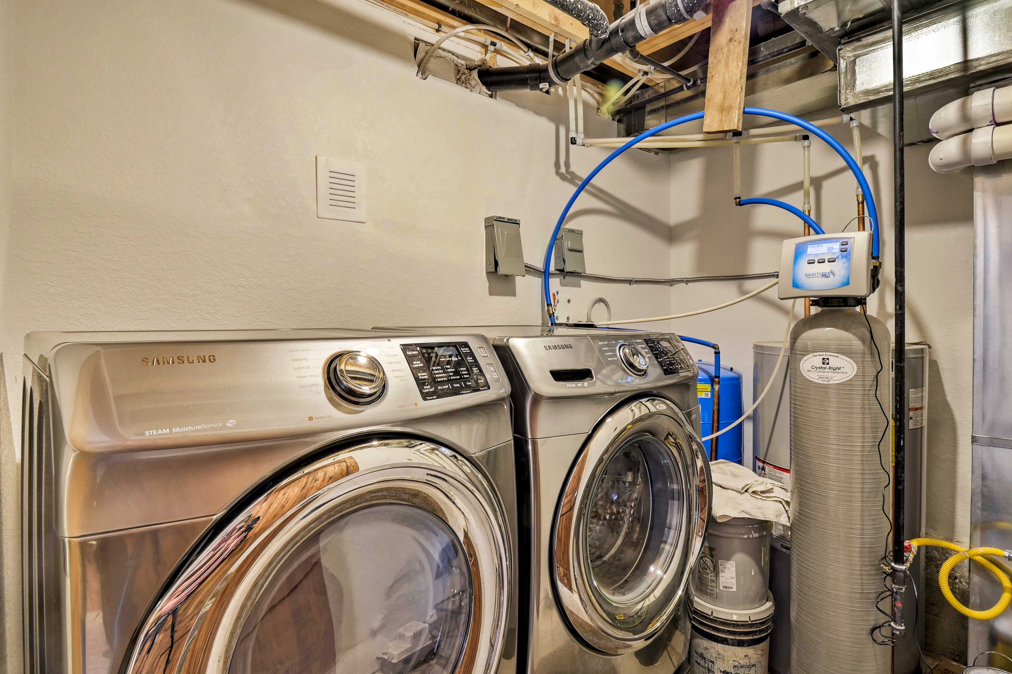 The washer and dryer are located off the living room.