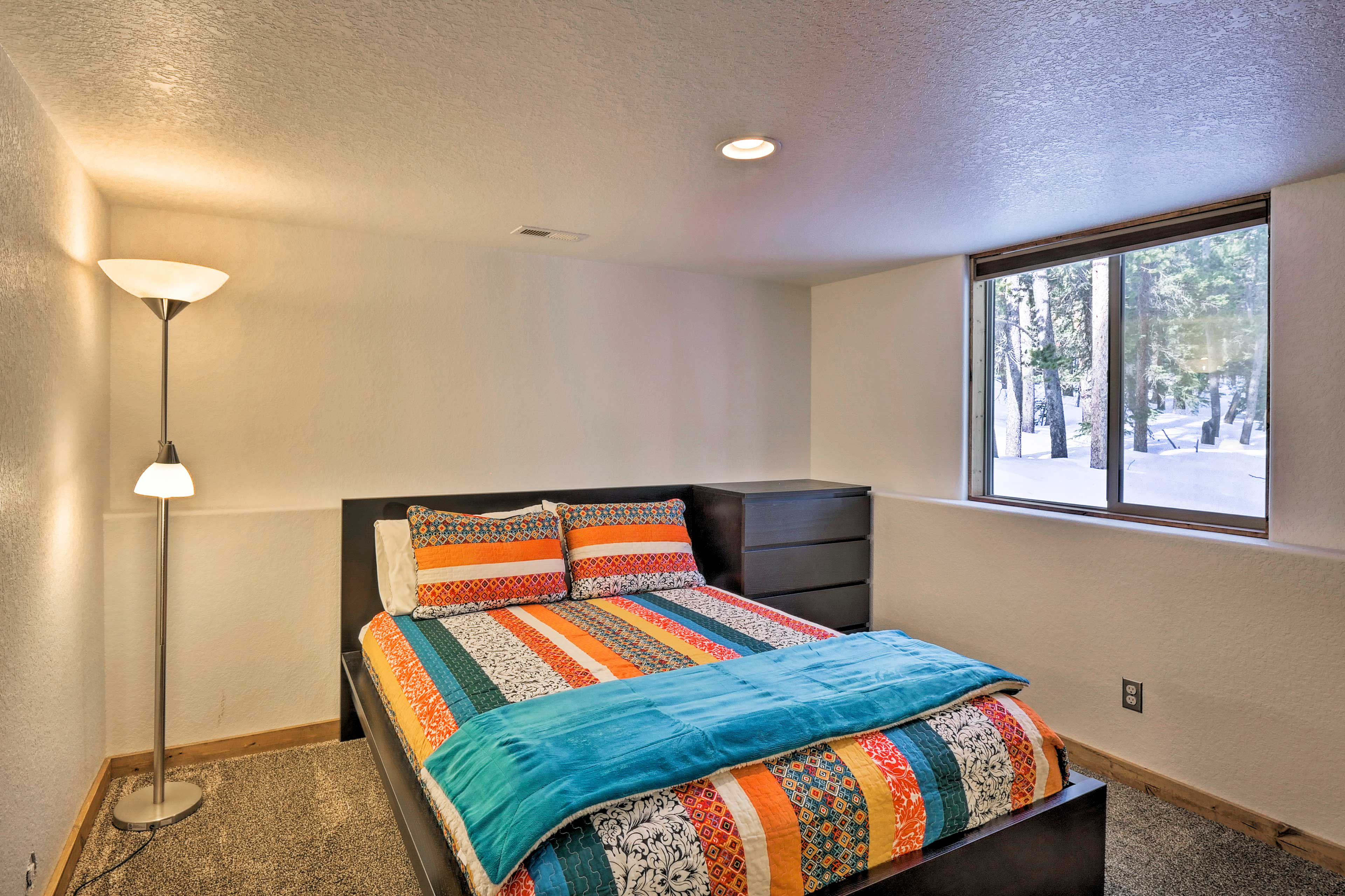 The downstairs bedroom includes a queen bed.
