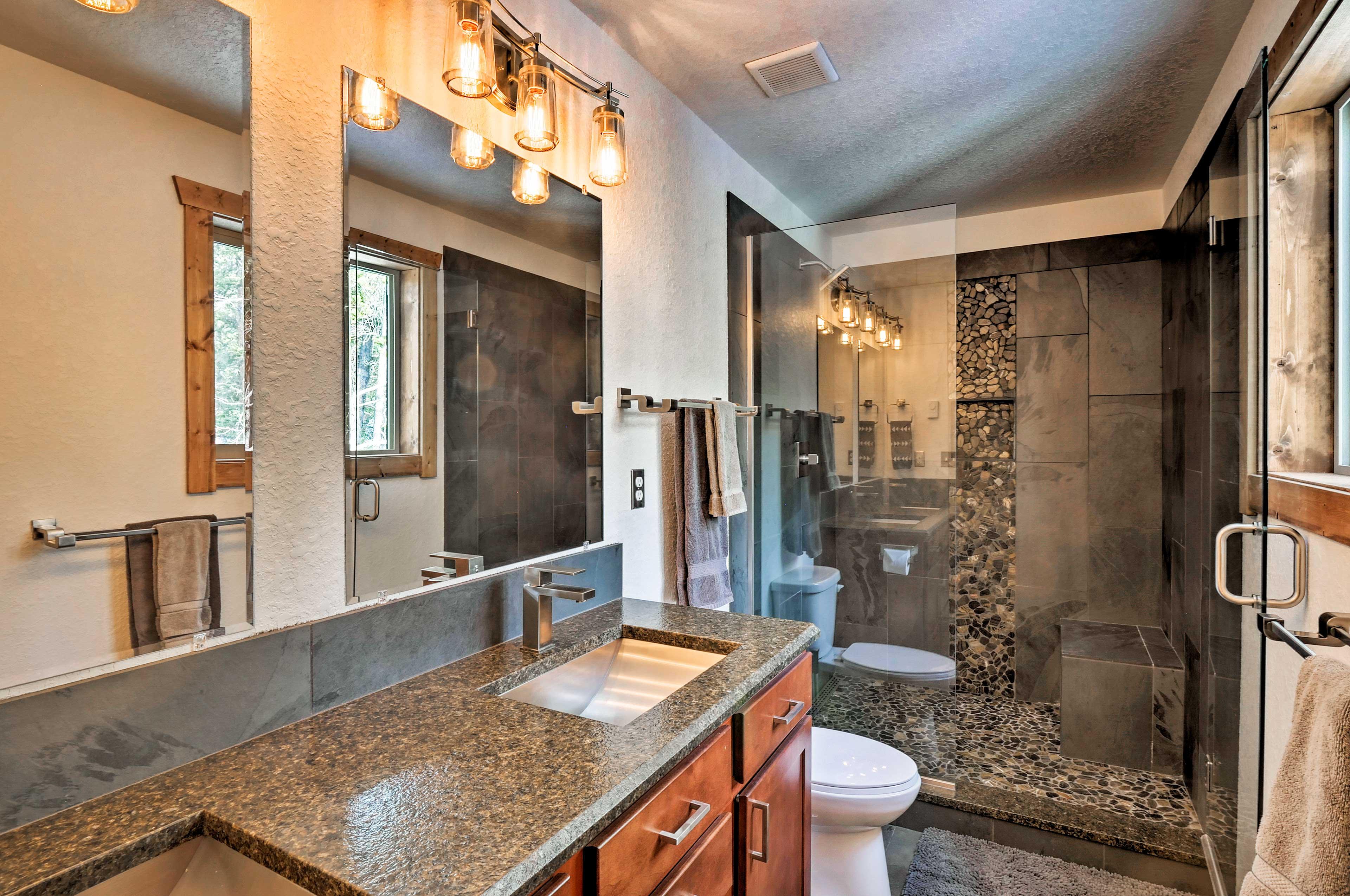 The en-suite bathroom has a large walk-in shower.