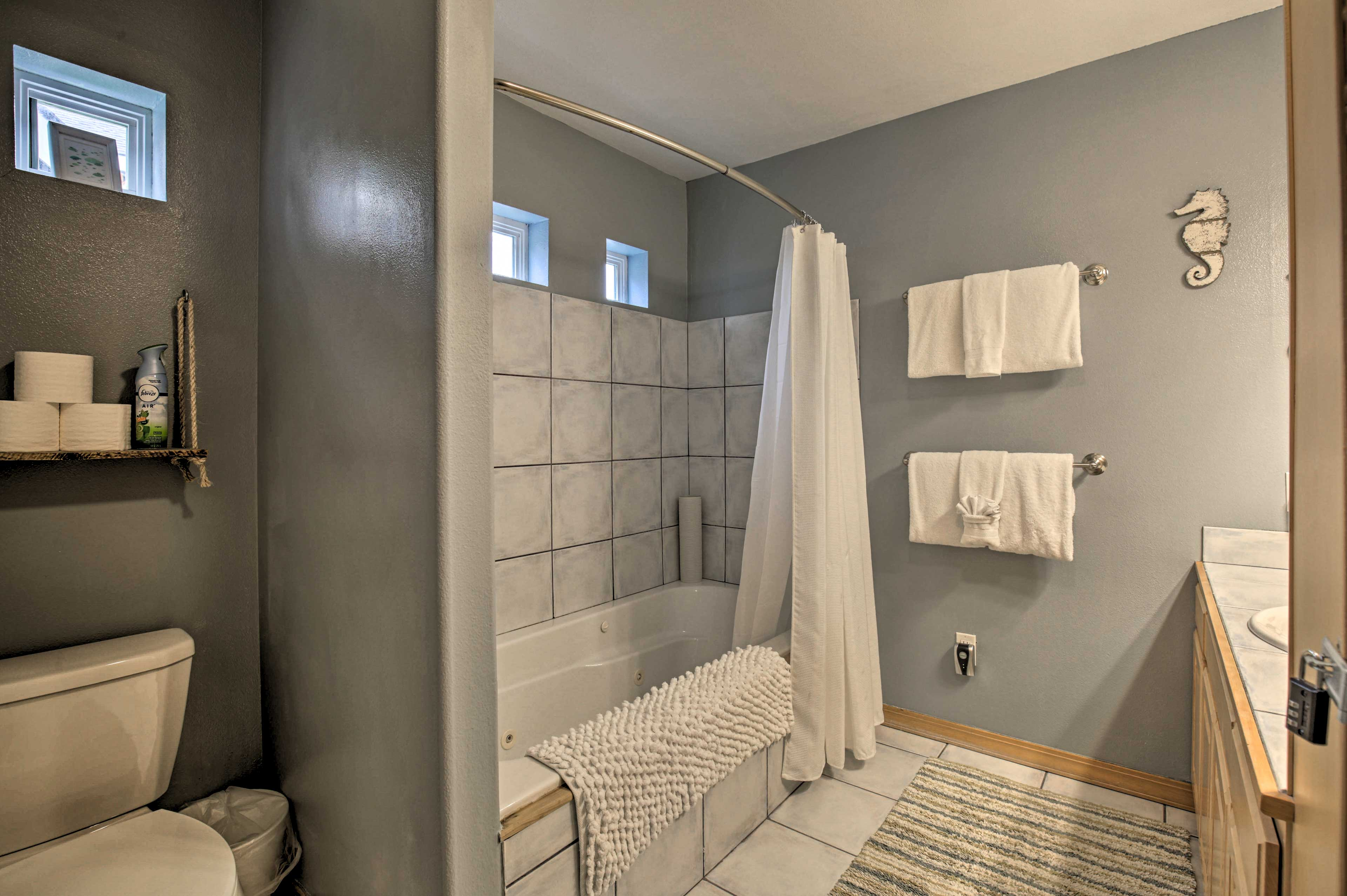 Take a relaxing shower or bath in the jetted tub.