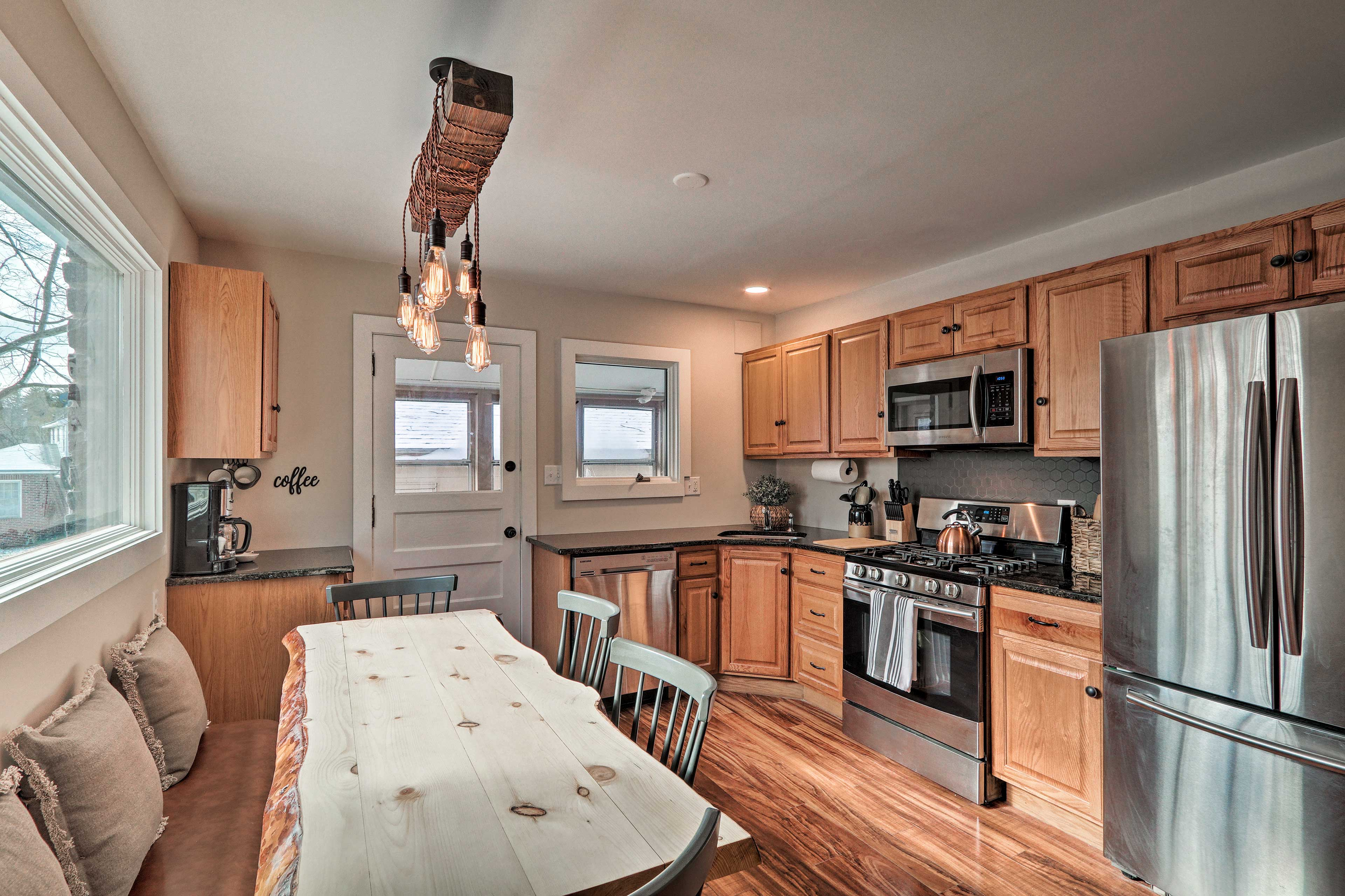 The modern kitchen is equipped with stainless steel appliances.