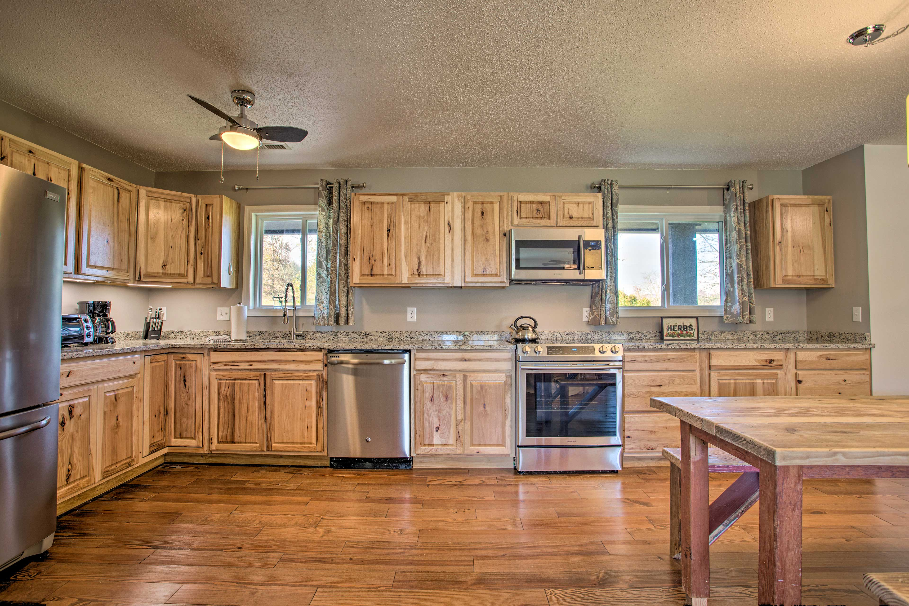The spacious, gourmet kitchen is perfect for meal collaboration.