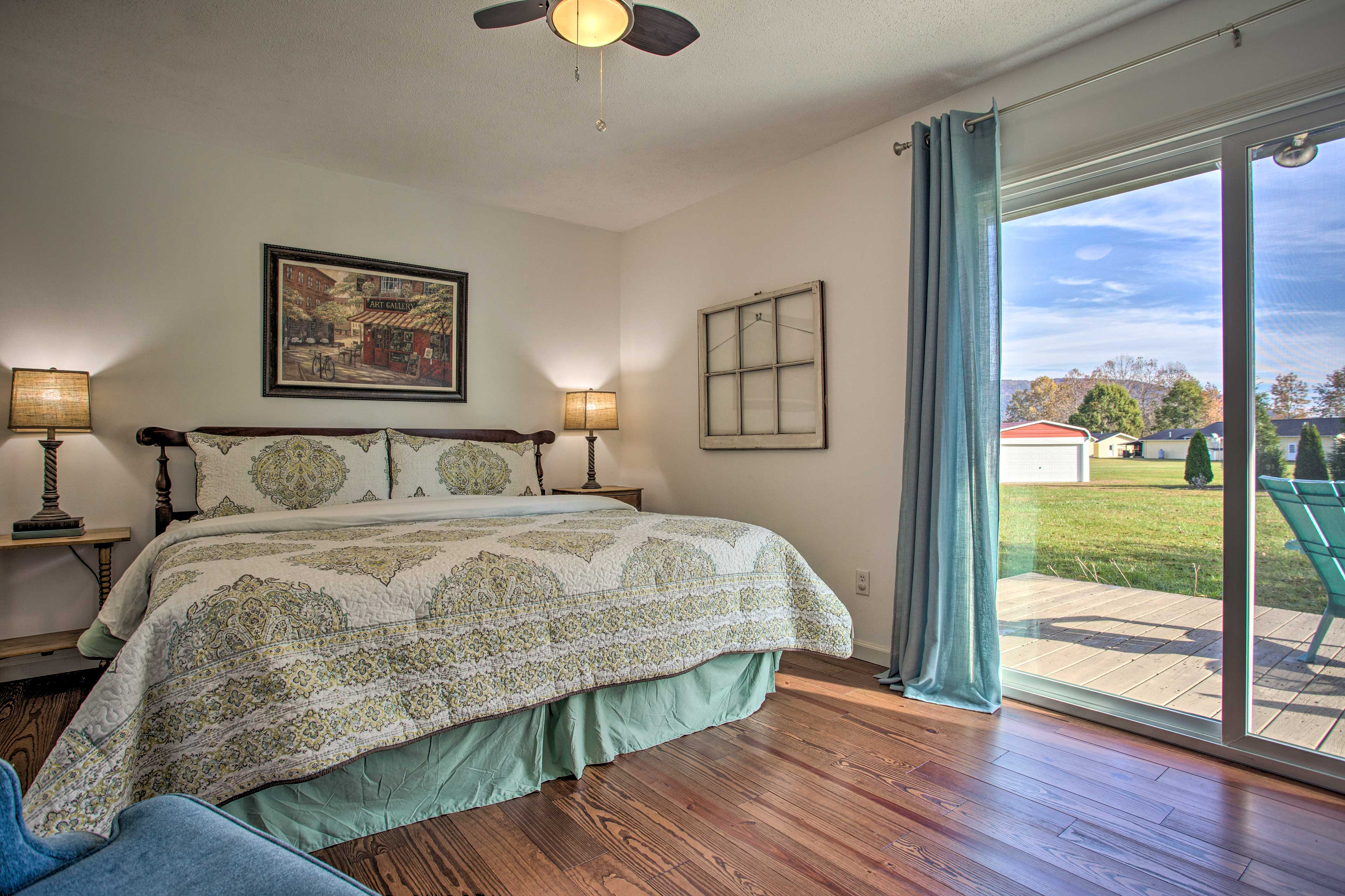 The master bedroom boasts deck access and a king-sized bed.