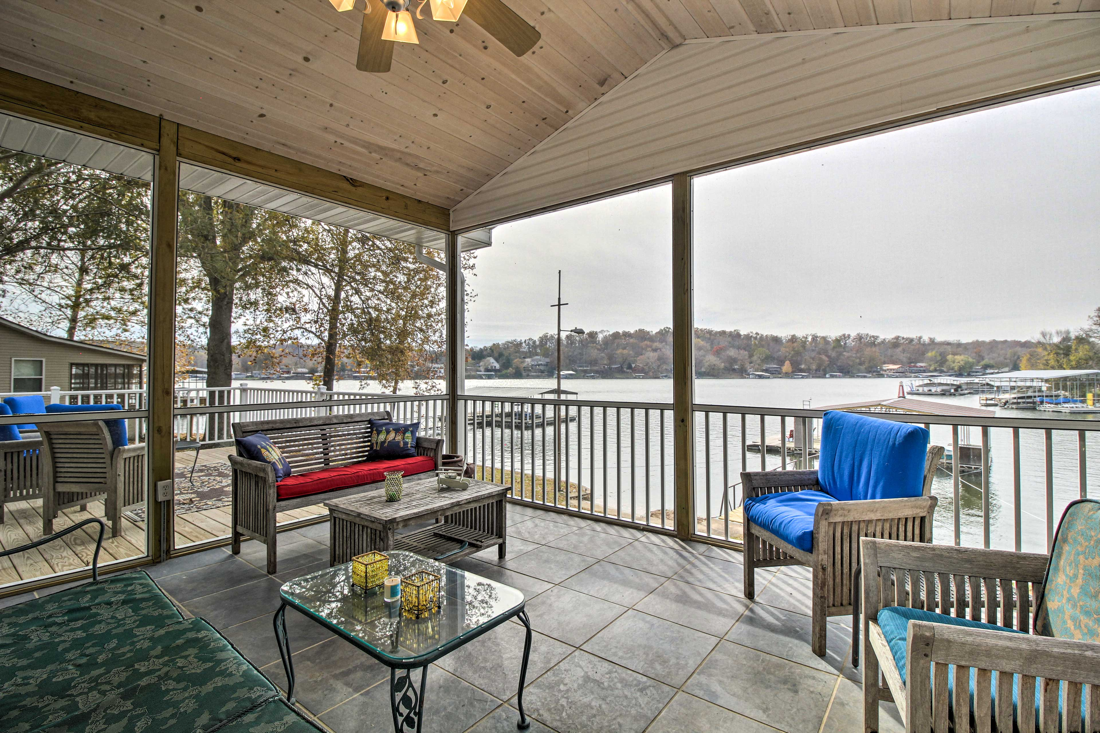 Admire the lake from this screened-in deck area.