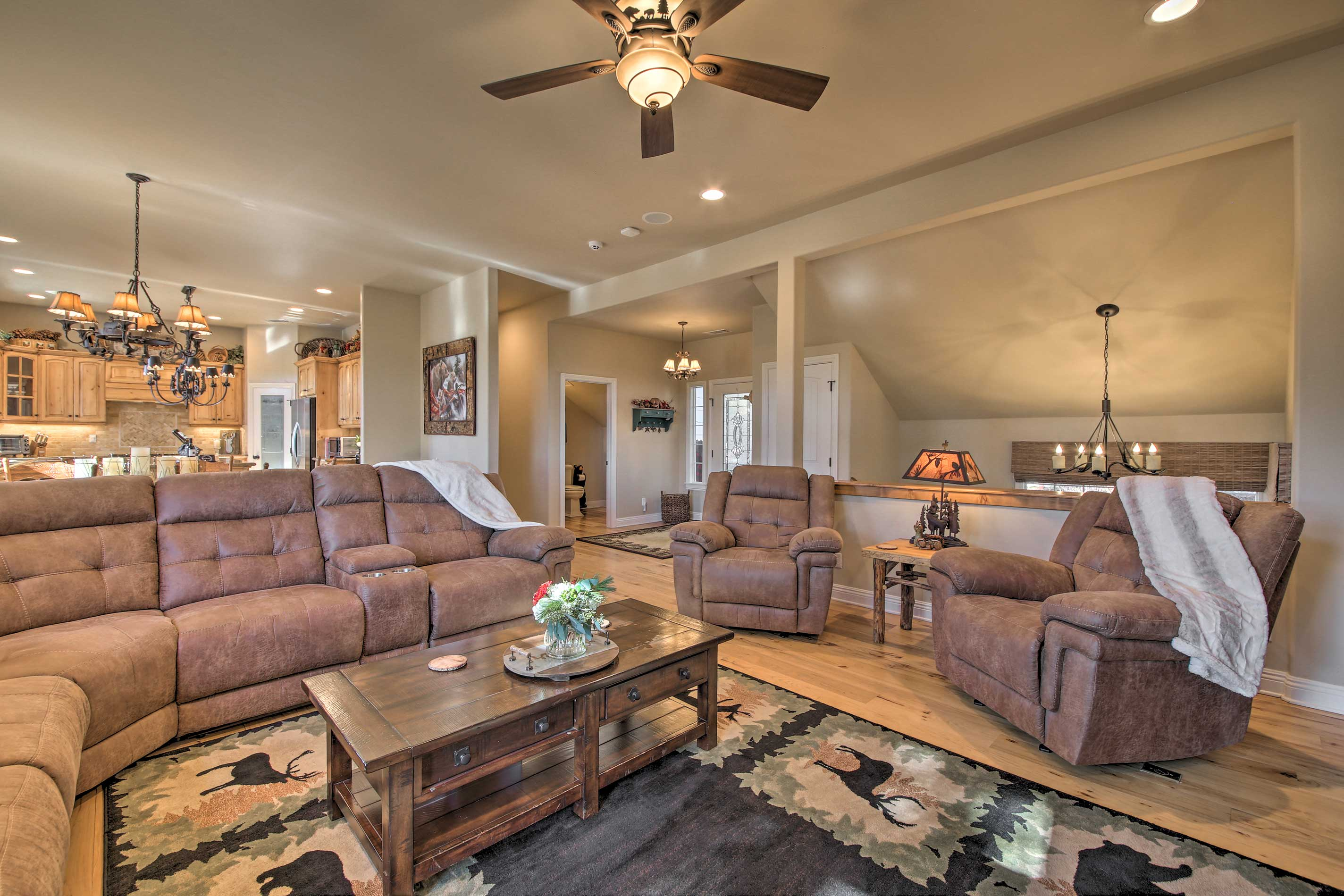 Rest your feet in one of the living room's comfy reclining chairs.