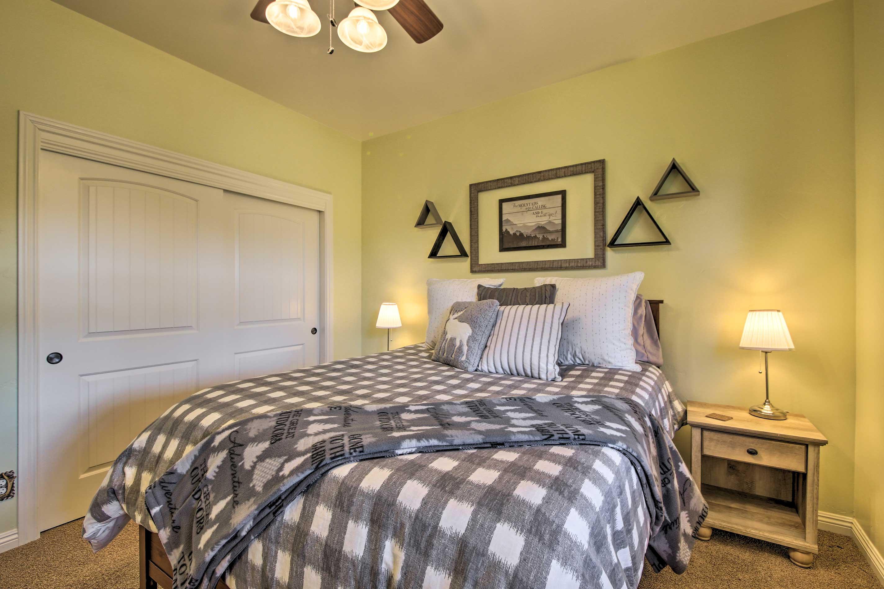 Feeling sleepy? Retire to this room's cozy queen bed.