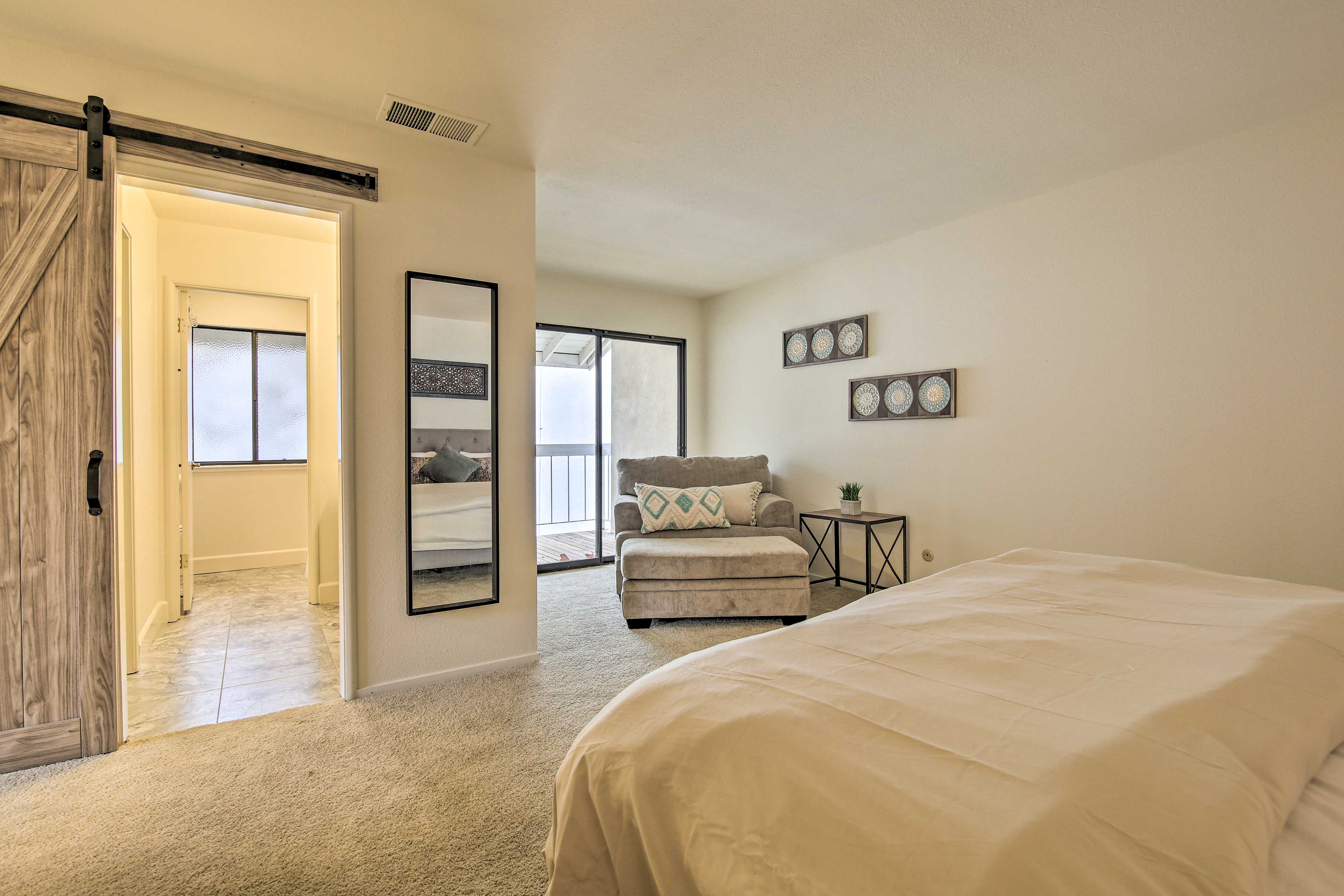 Walk outside on to the balcony or head to the en-suite bathroom.