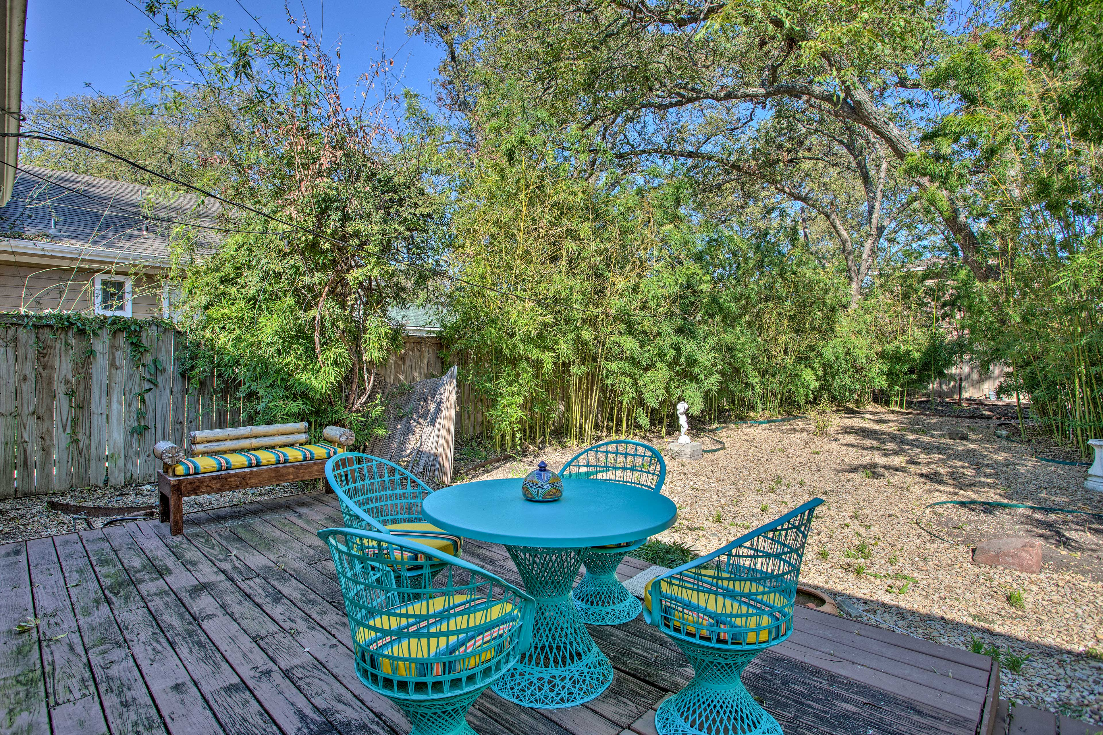 This charming bungalow boasts a deck, fenced backyard, and more.