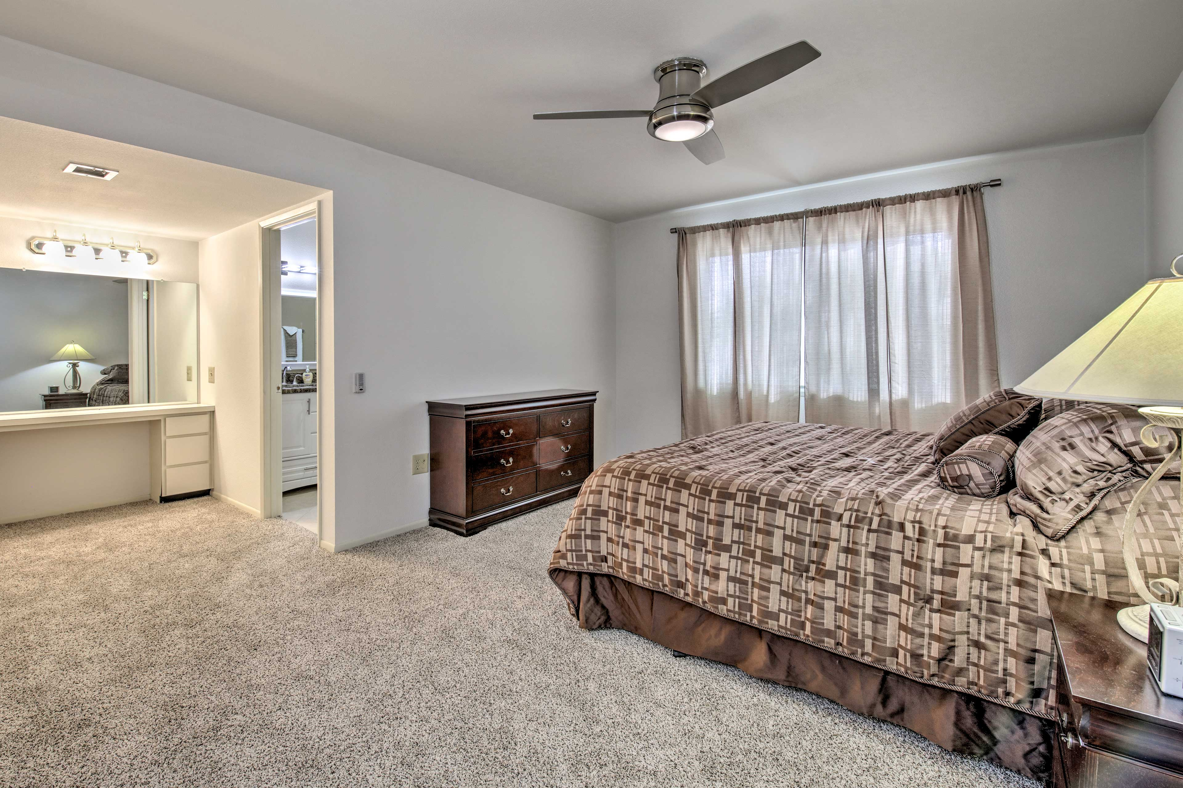 The master bedroom hosts a king bed and en-suite bathroom.