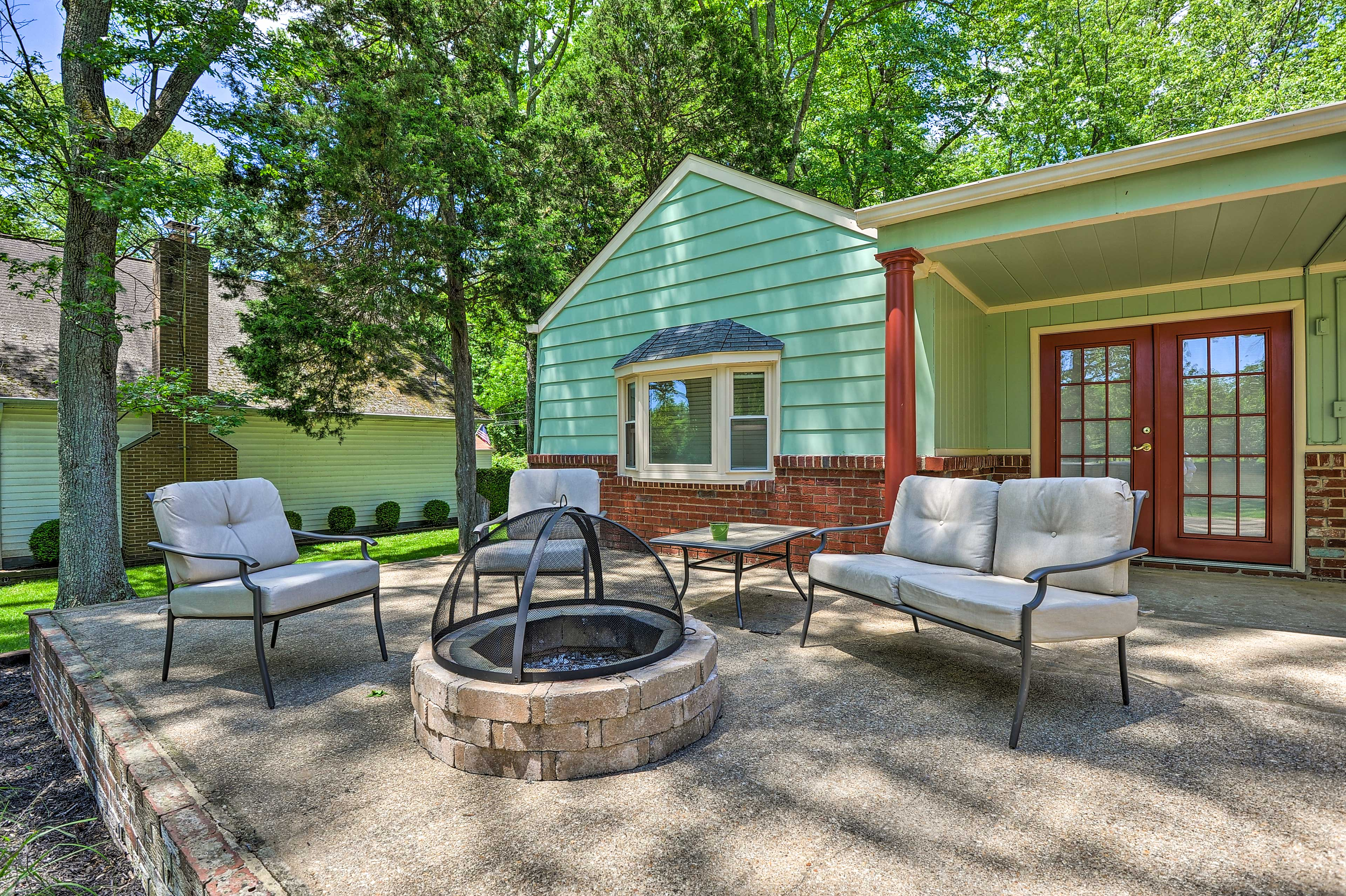 This vacation rental features and outdoor entertainment space out back.