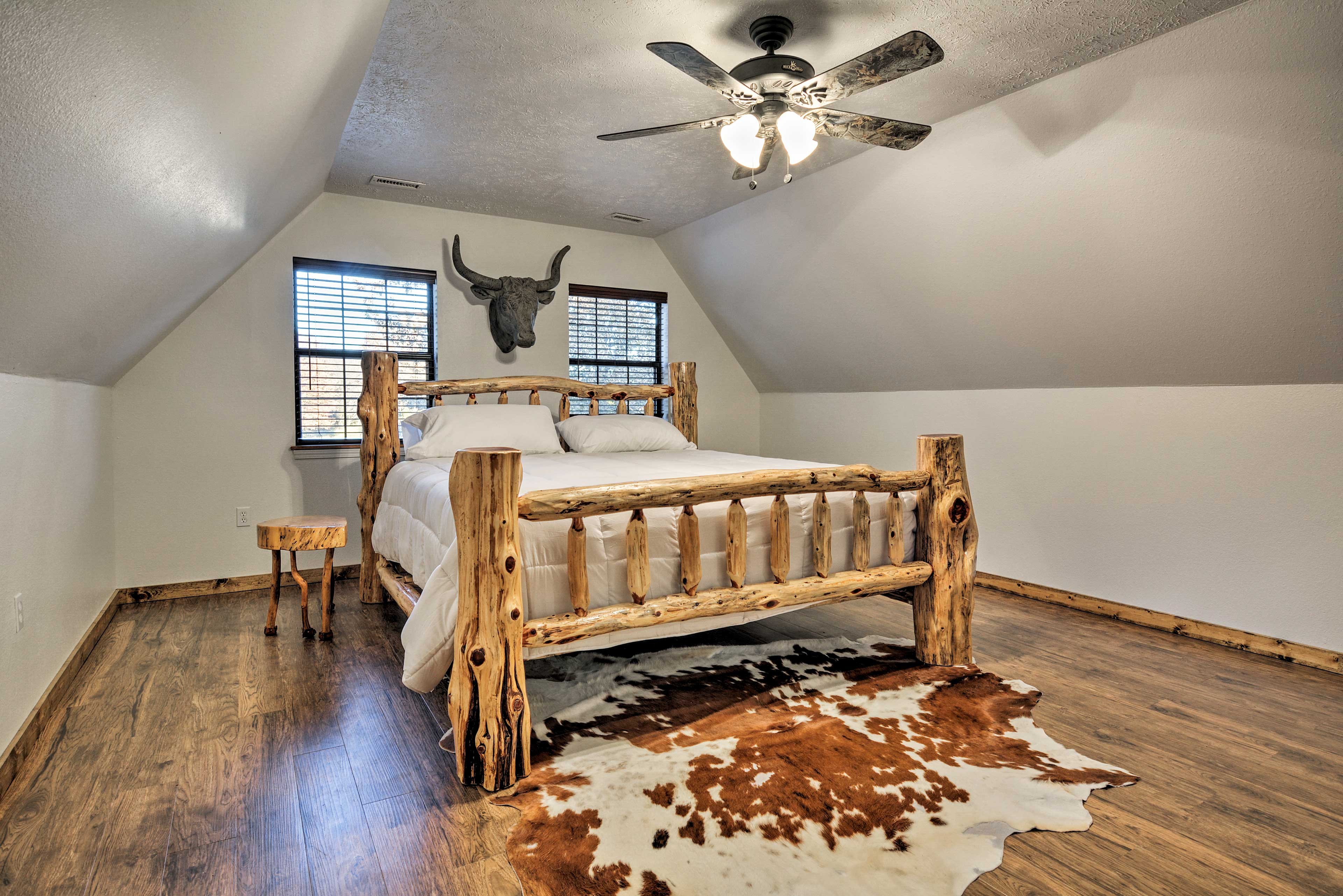 Two guests can sleep comfortably in this king bed.