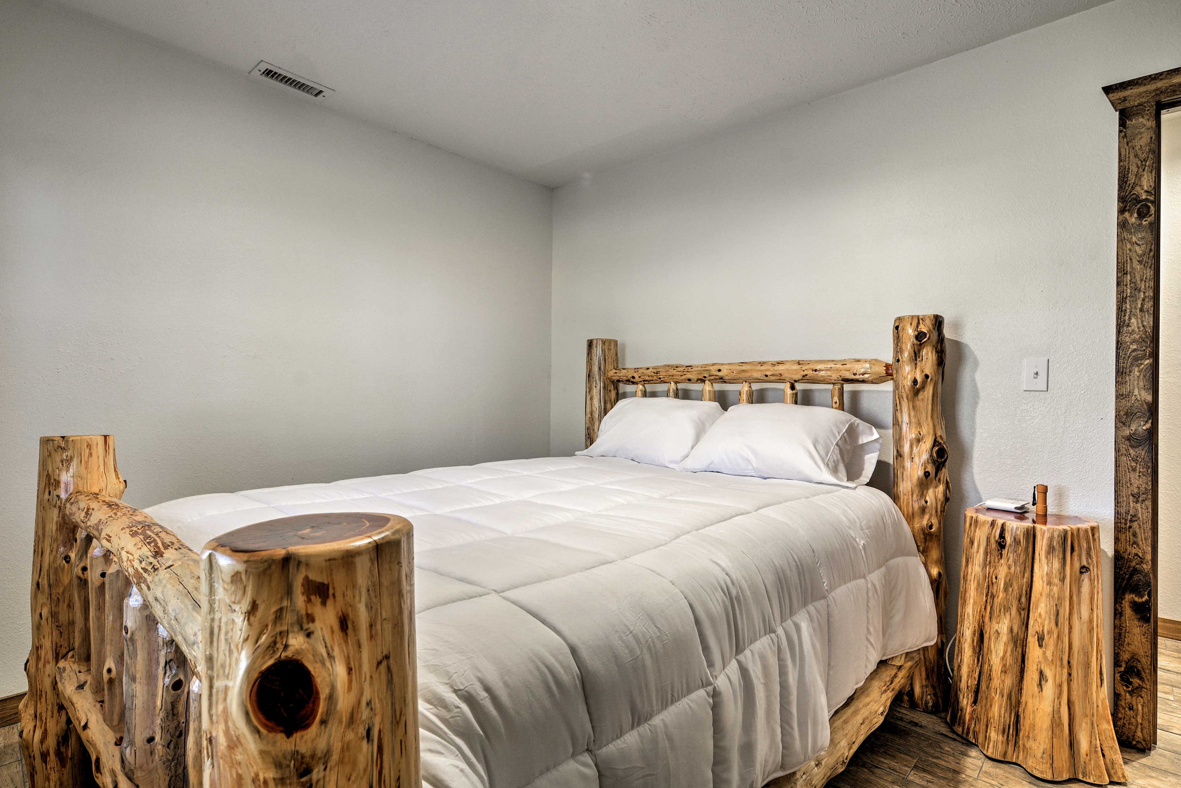 Drift to sleep in this queen bed.