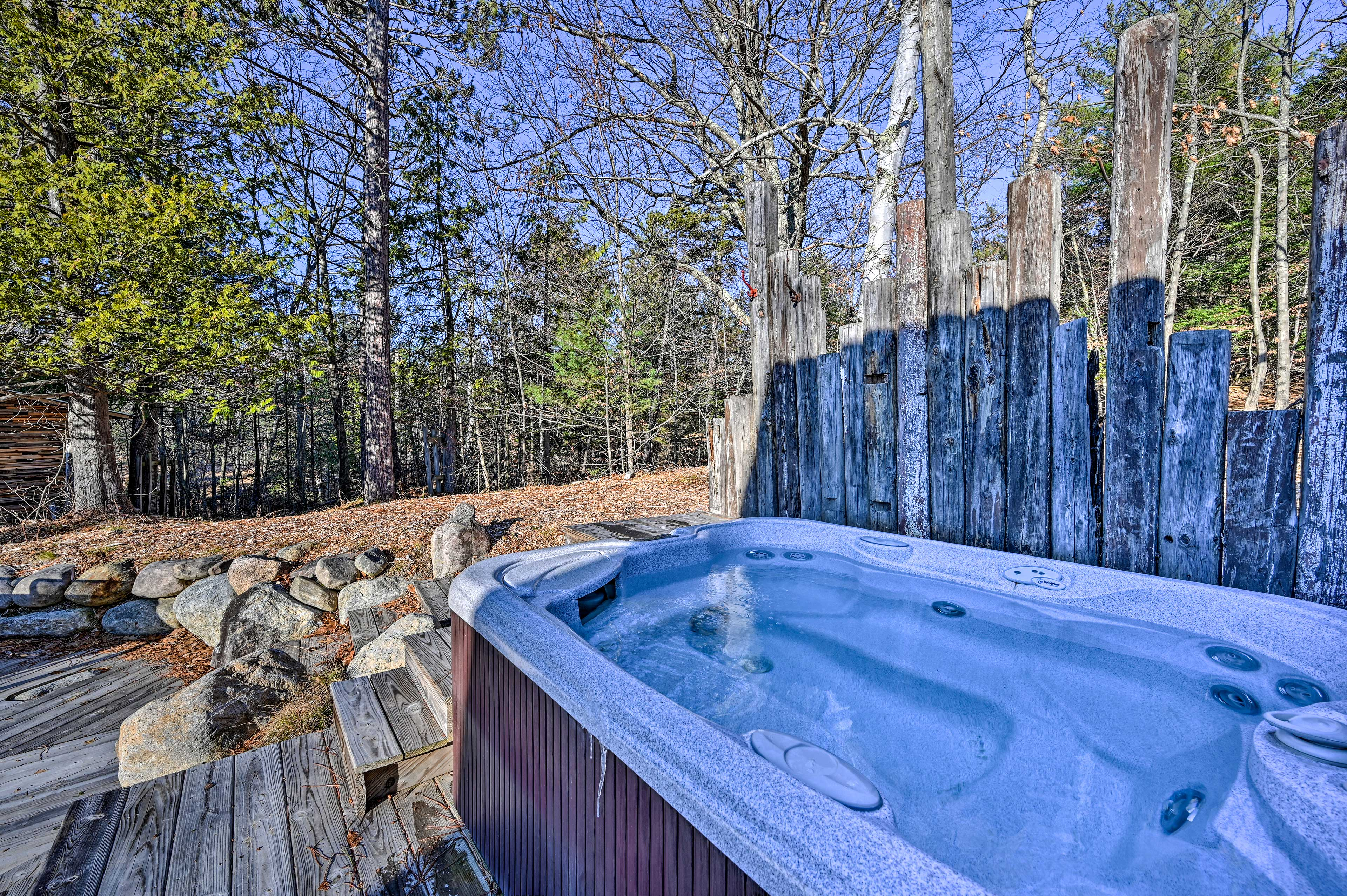 Soak sore skiing muscles in the private hot tub.