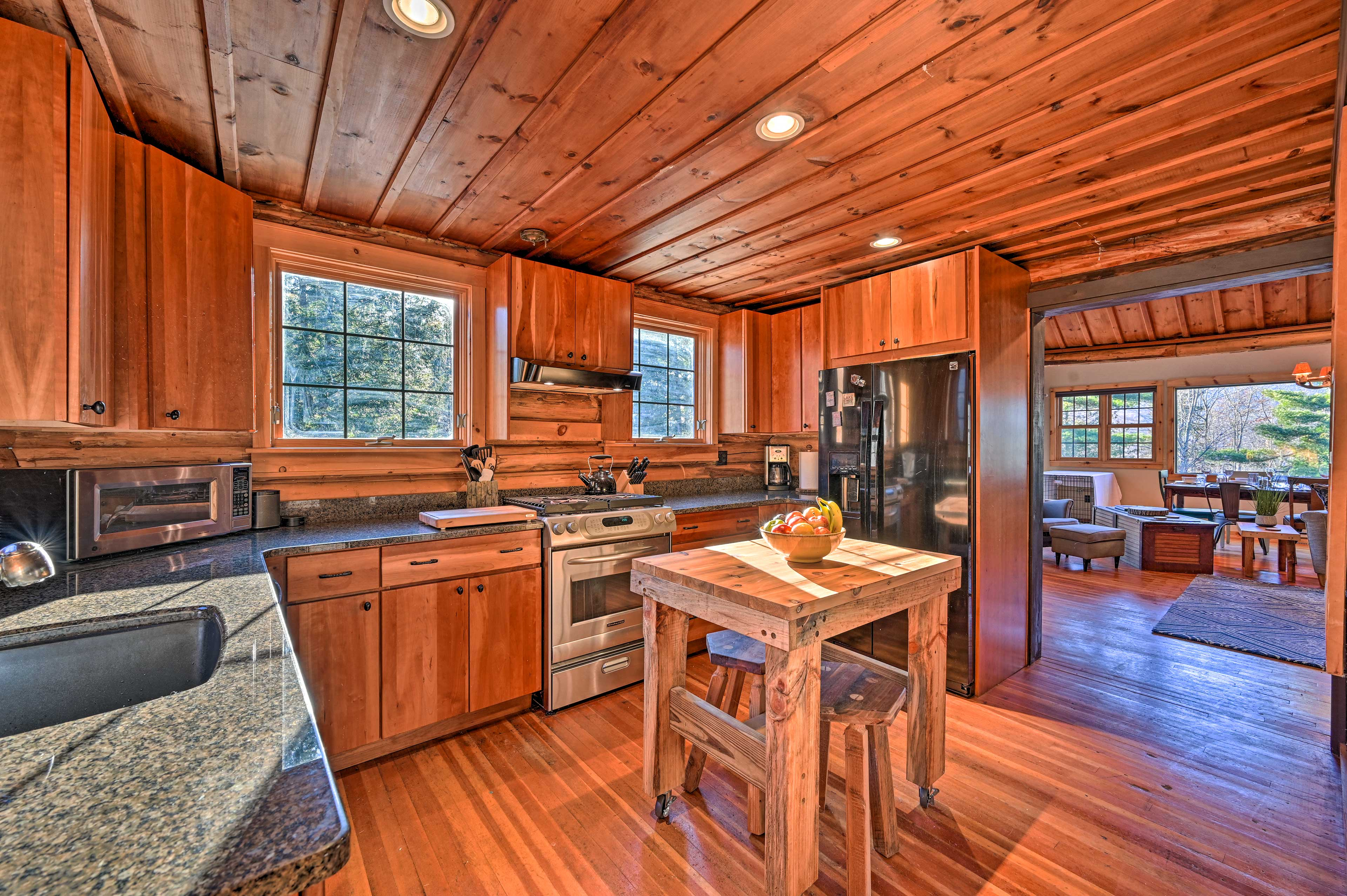 The wooden butcher block table competes this kitchen.