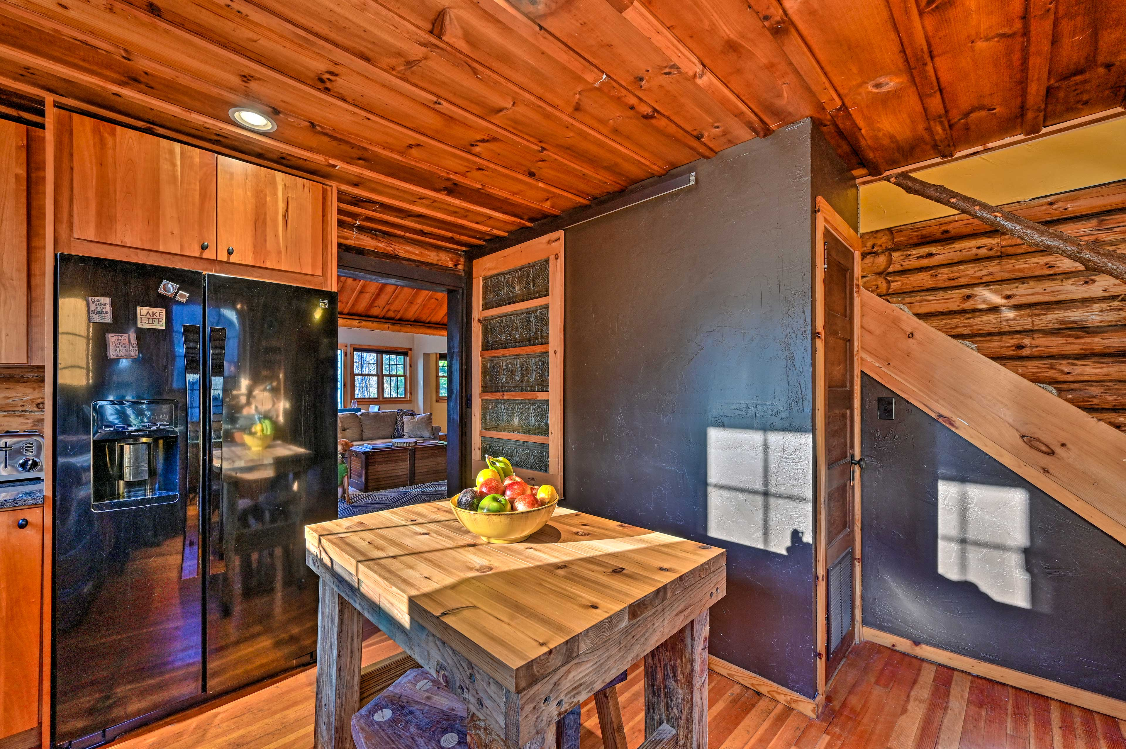 Admire the authentic wood accents and vaulted ceilings.