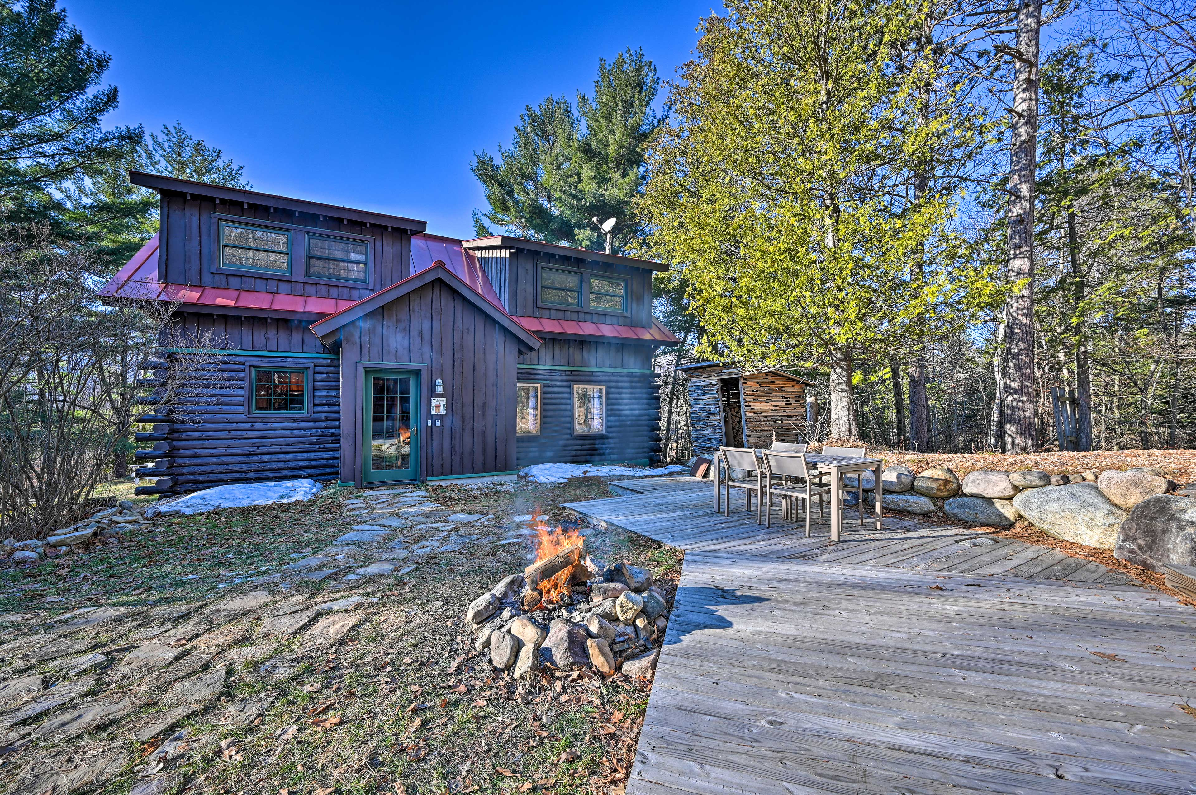 Escape to the mountains for a relaxing stay at this cozy Wilmington log cabin!