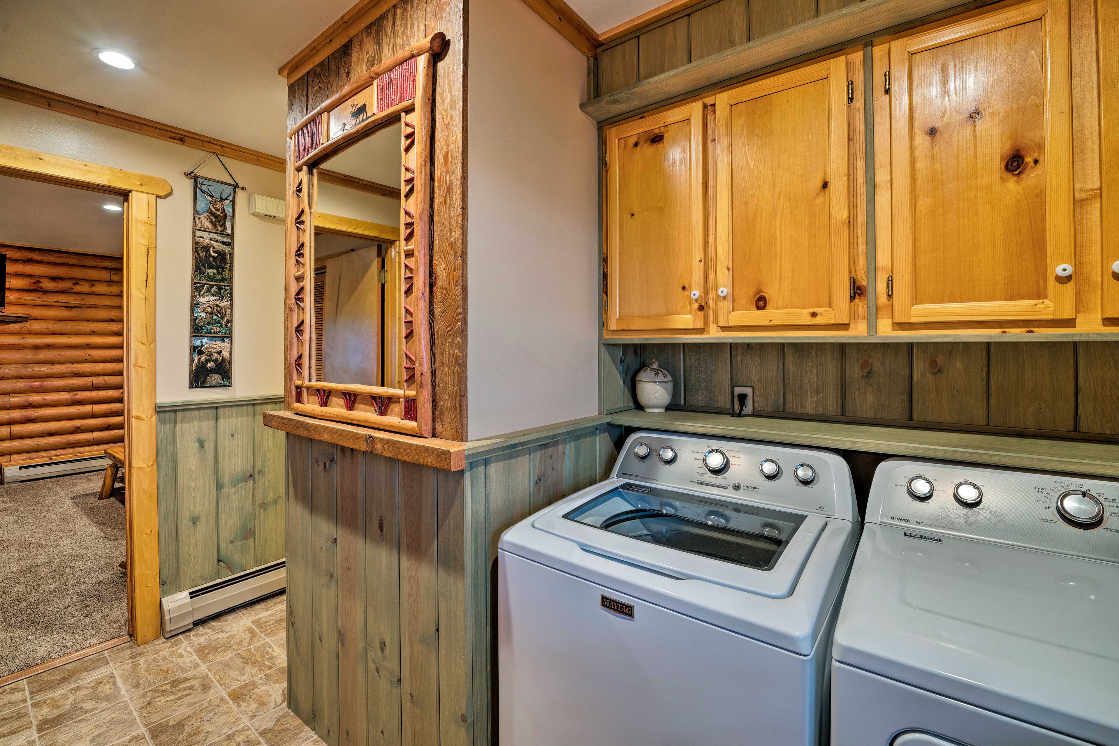 The washer and dryer, located in the hallway, will keep all your clothes clean.