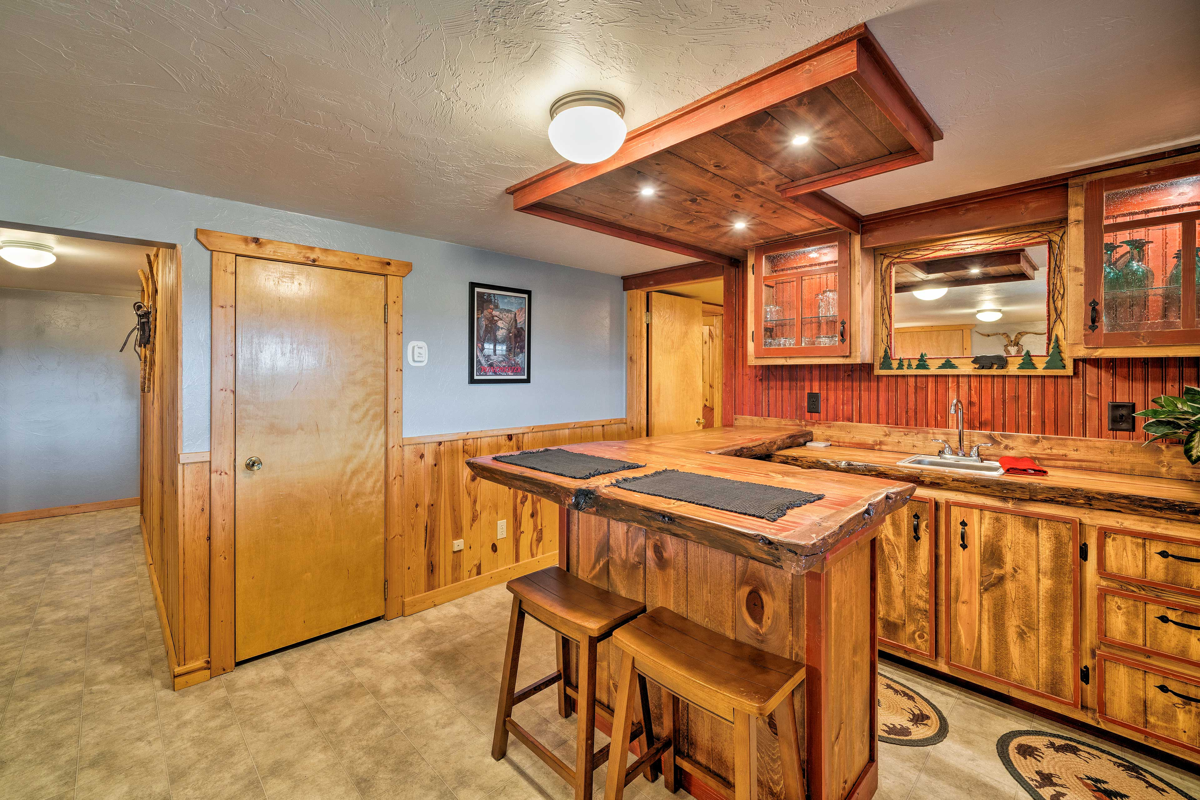Downstairs, you'll find a wet bar!