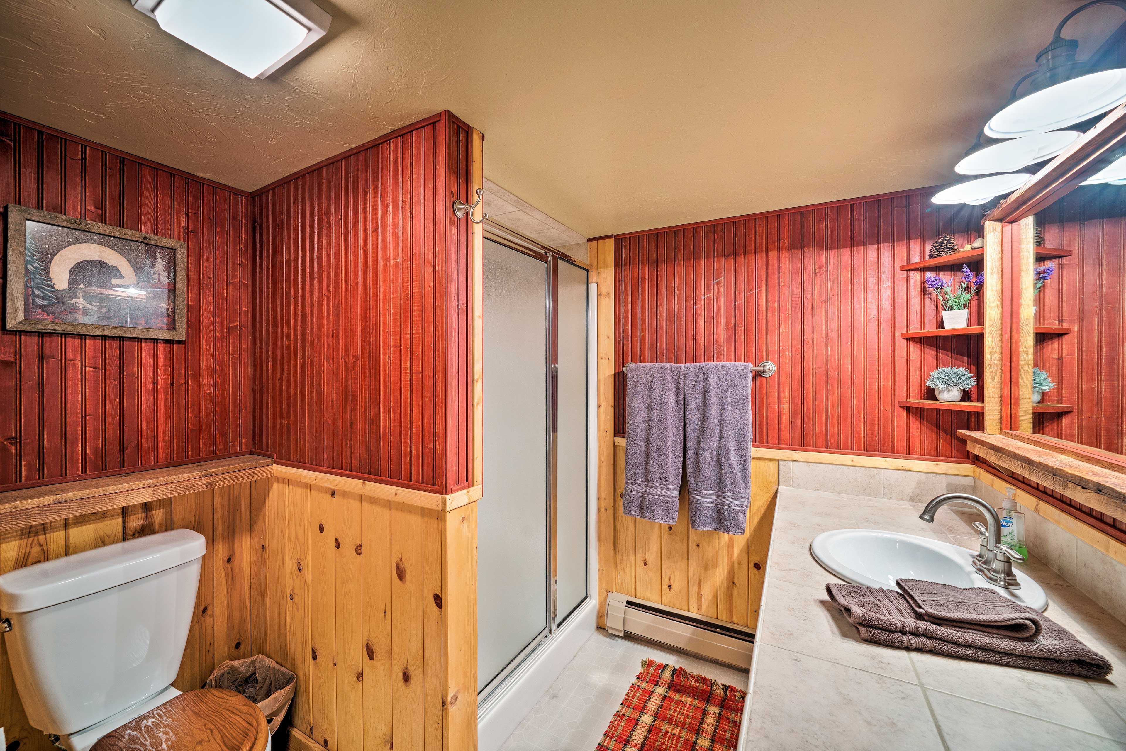 The room has an en-suite bathroom with a walk-in shower.