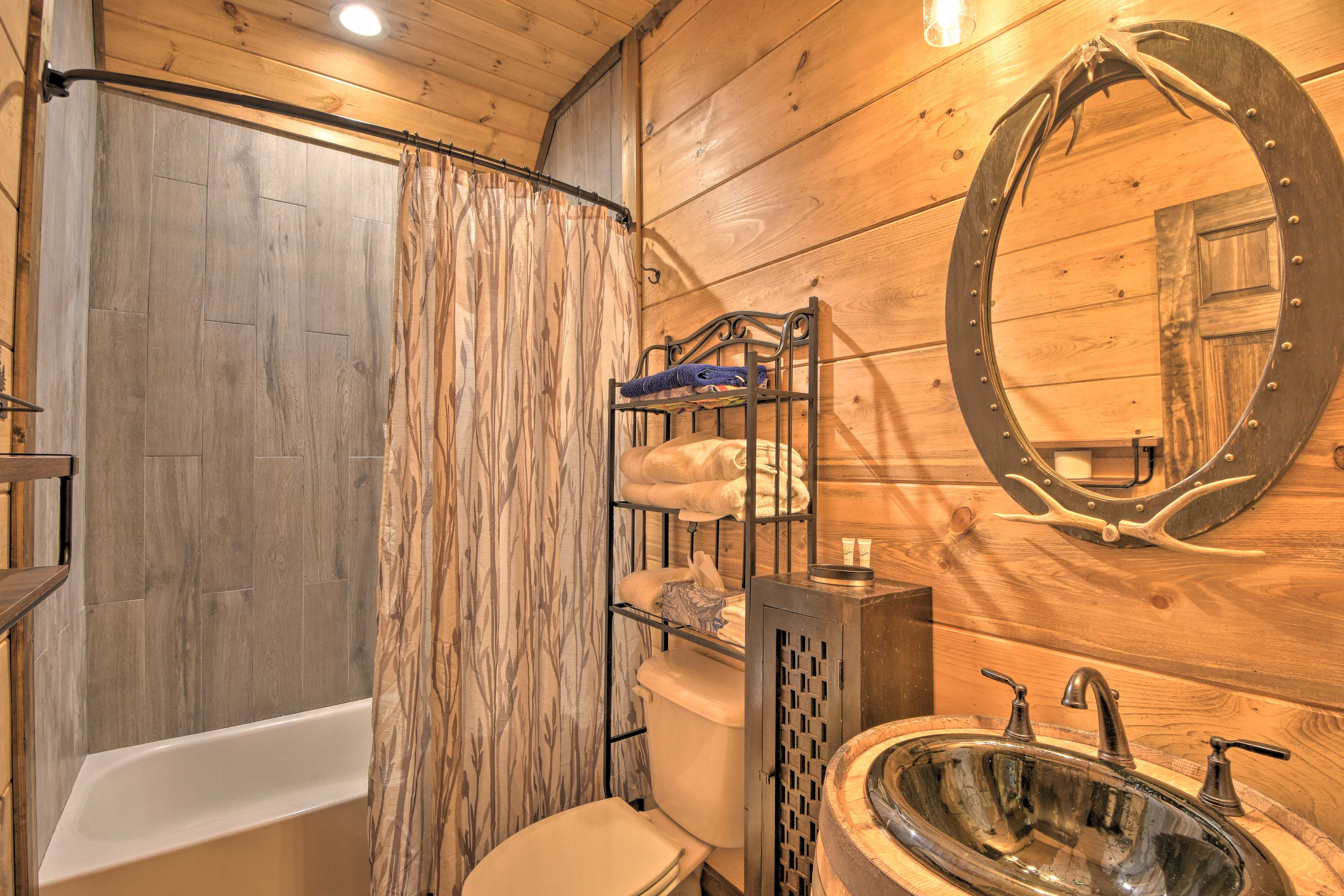 This rustic bathroom is the perfect place to freshen up.