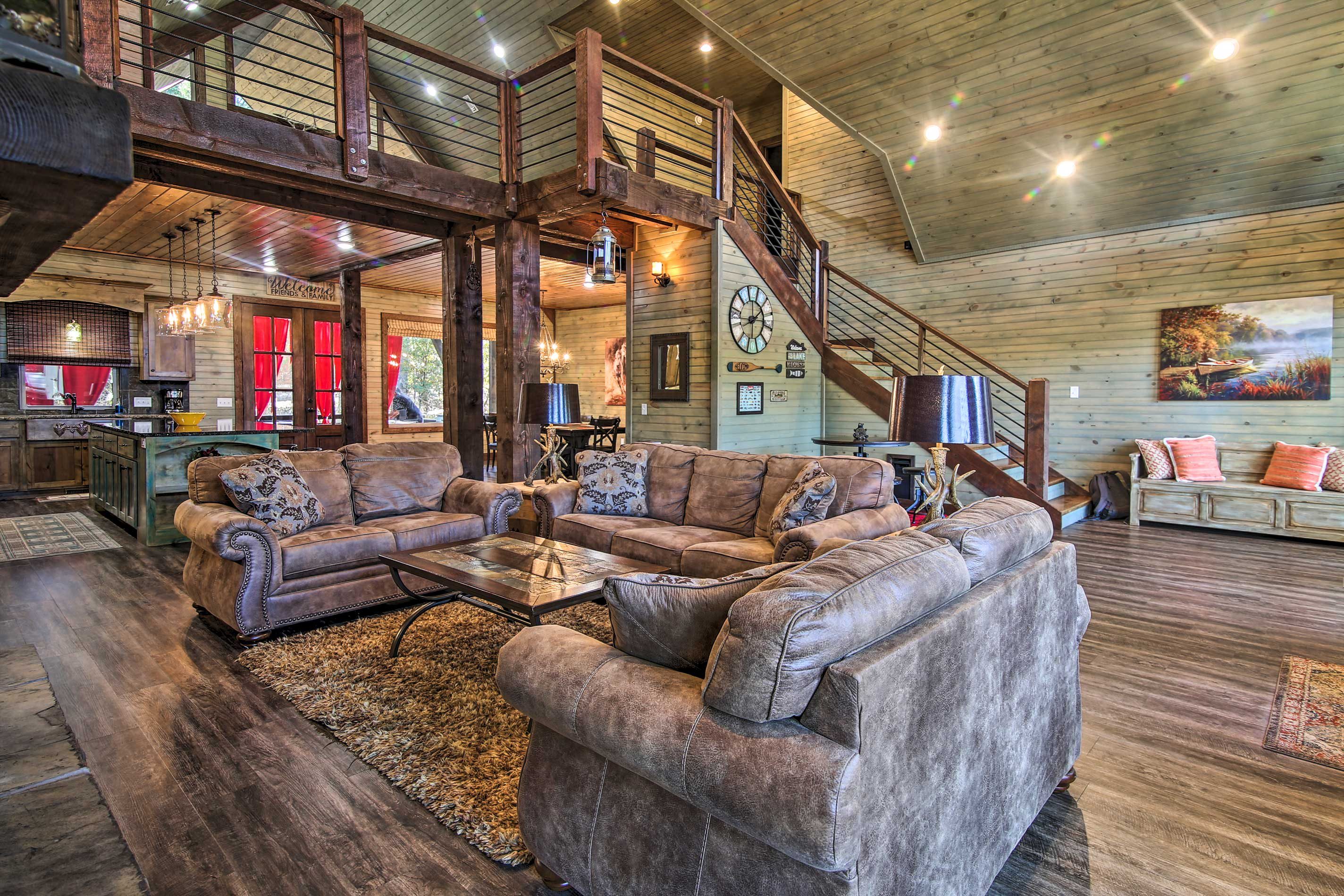 Vaulted ceilings and wooden beams create a warm, inviting interior.