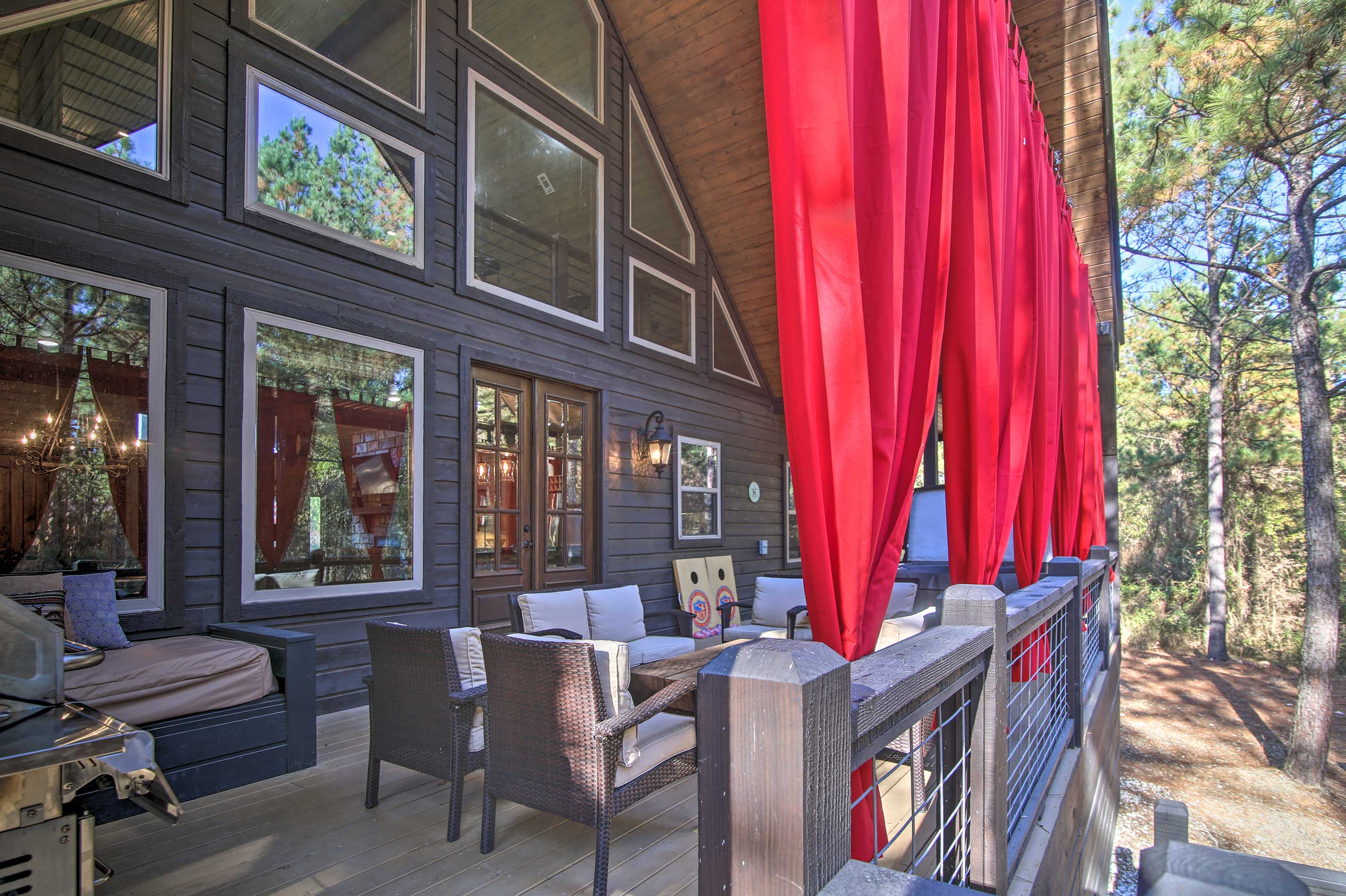 You may never want to leave this luxurious 4-bed, 4-bath woodland cabin!