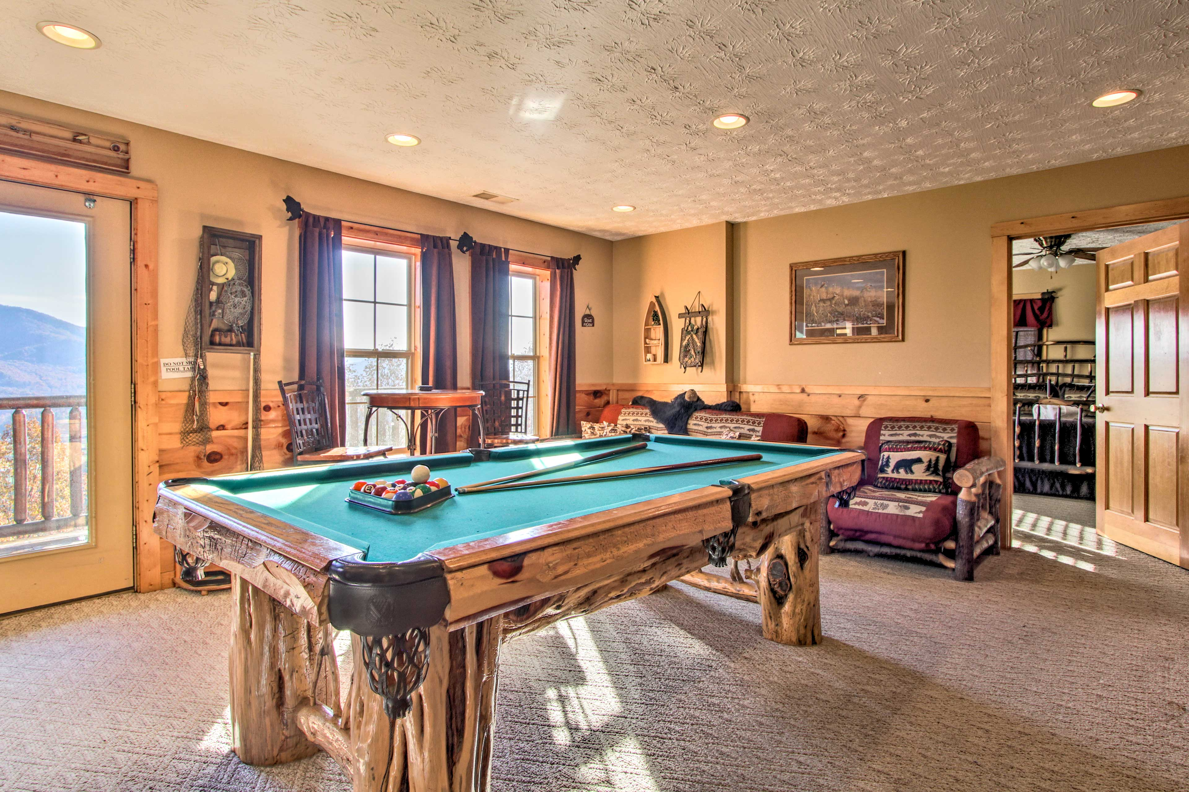 Reveal your inner pool shark in the downstairs media room's billiards table.