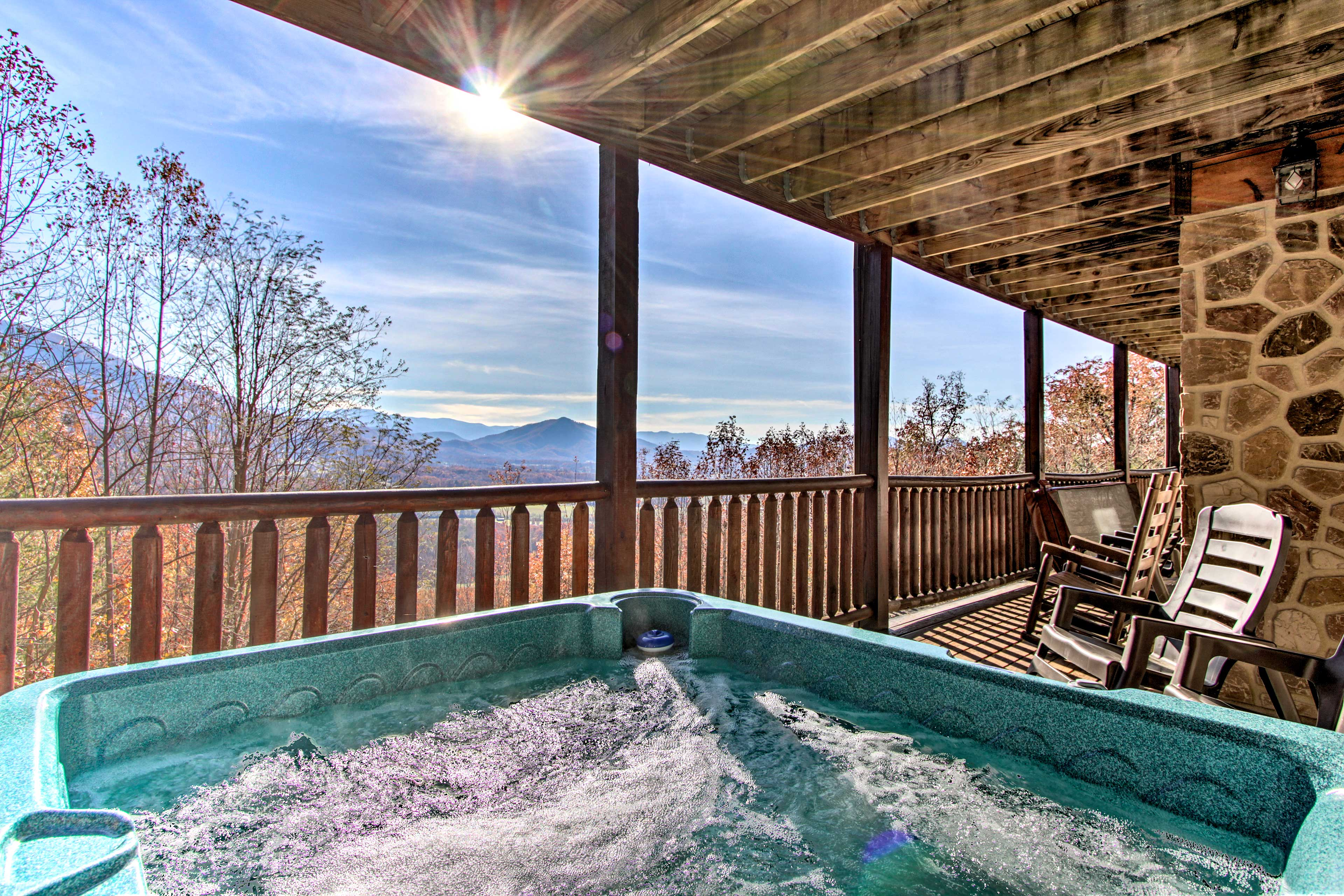 Up to 16 lucky guests will enjoy this home's deck with Smoky Mountain Views.
