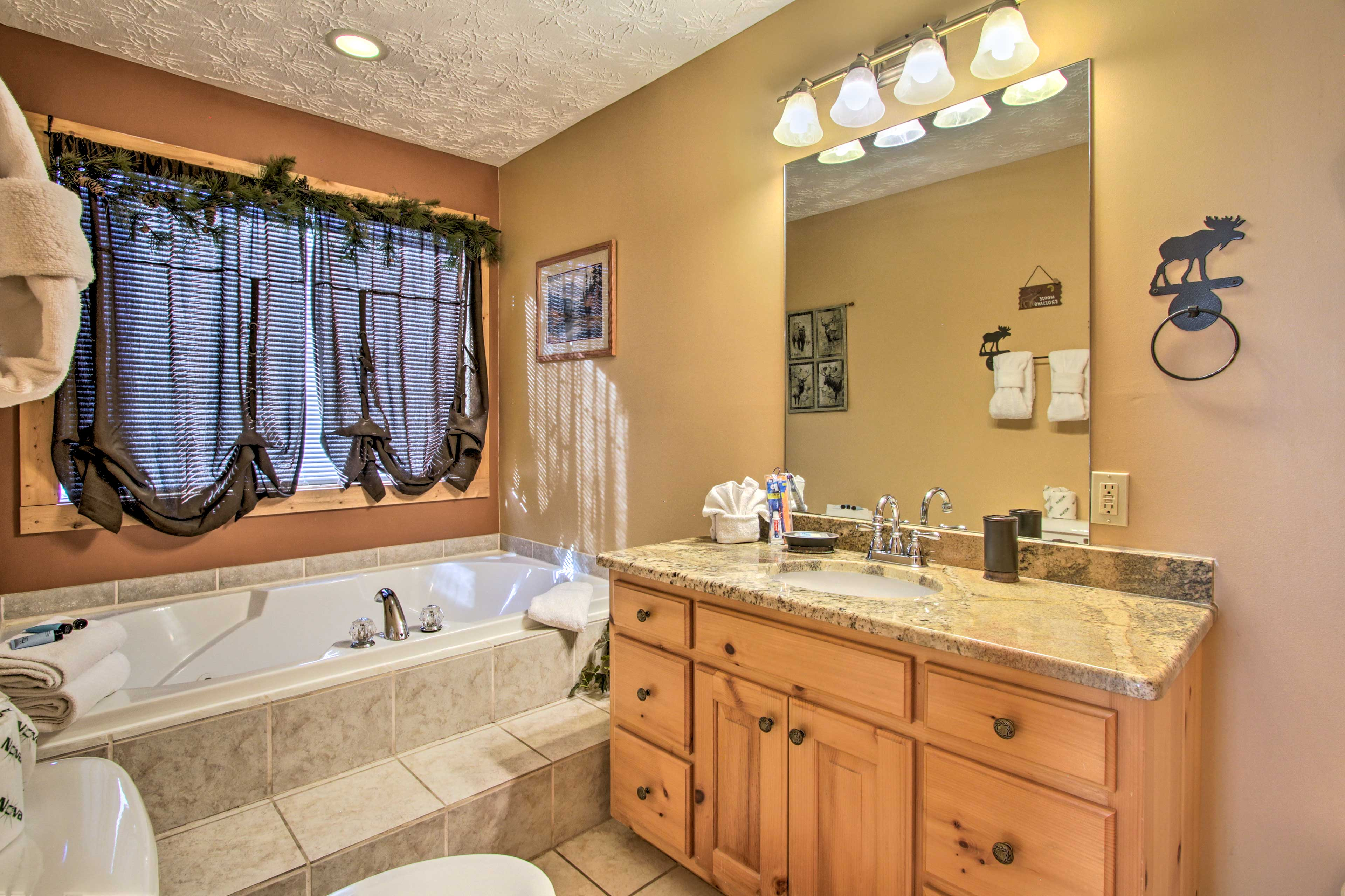 Enjoy a soak in the jetted garden tub found in 2 of the 4 full bathrooms.
