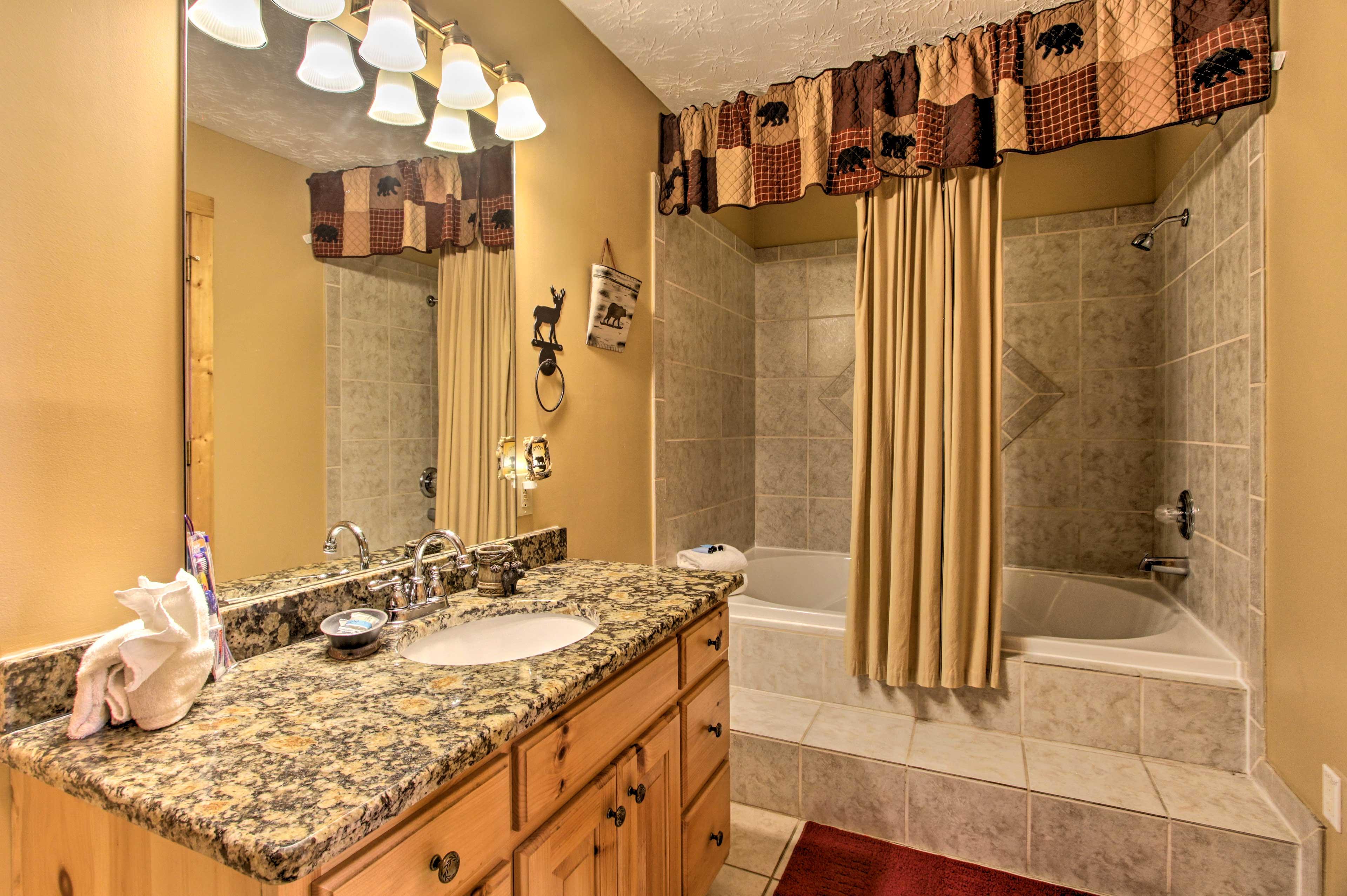 Rinse off in this pristine full bathroom.