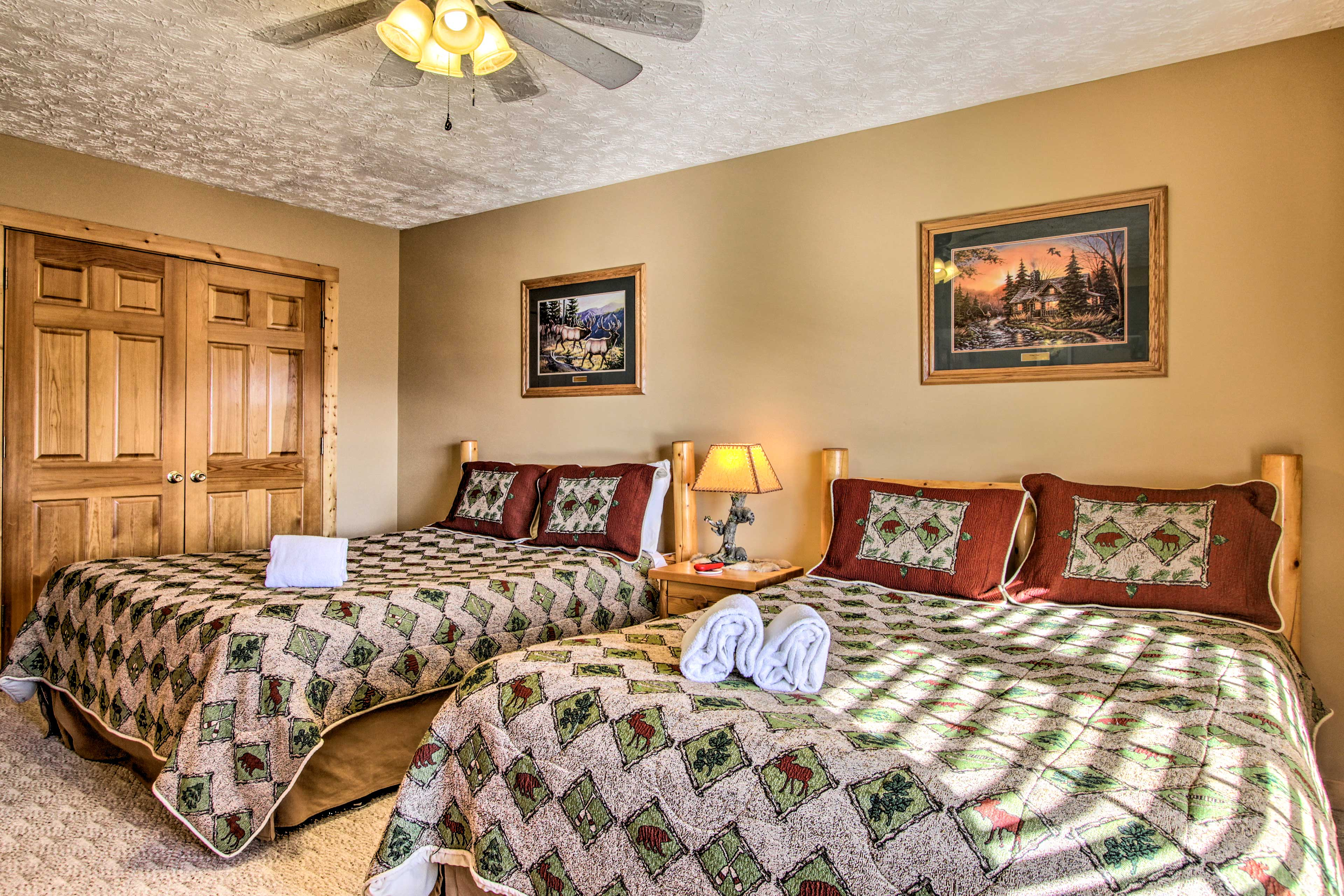 Make yourself at home in this downstairs bedroom with 2 queen beds.