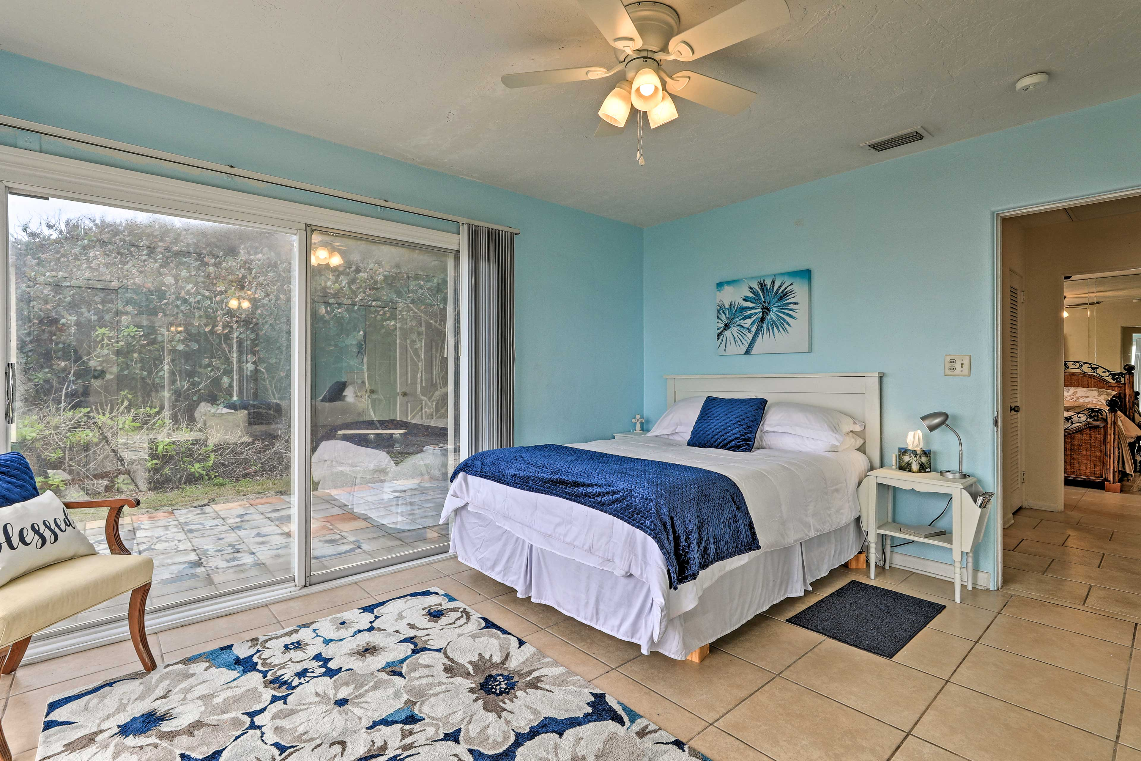 This nautically themed room has a queen bed.