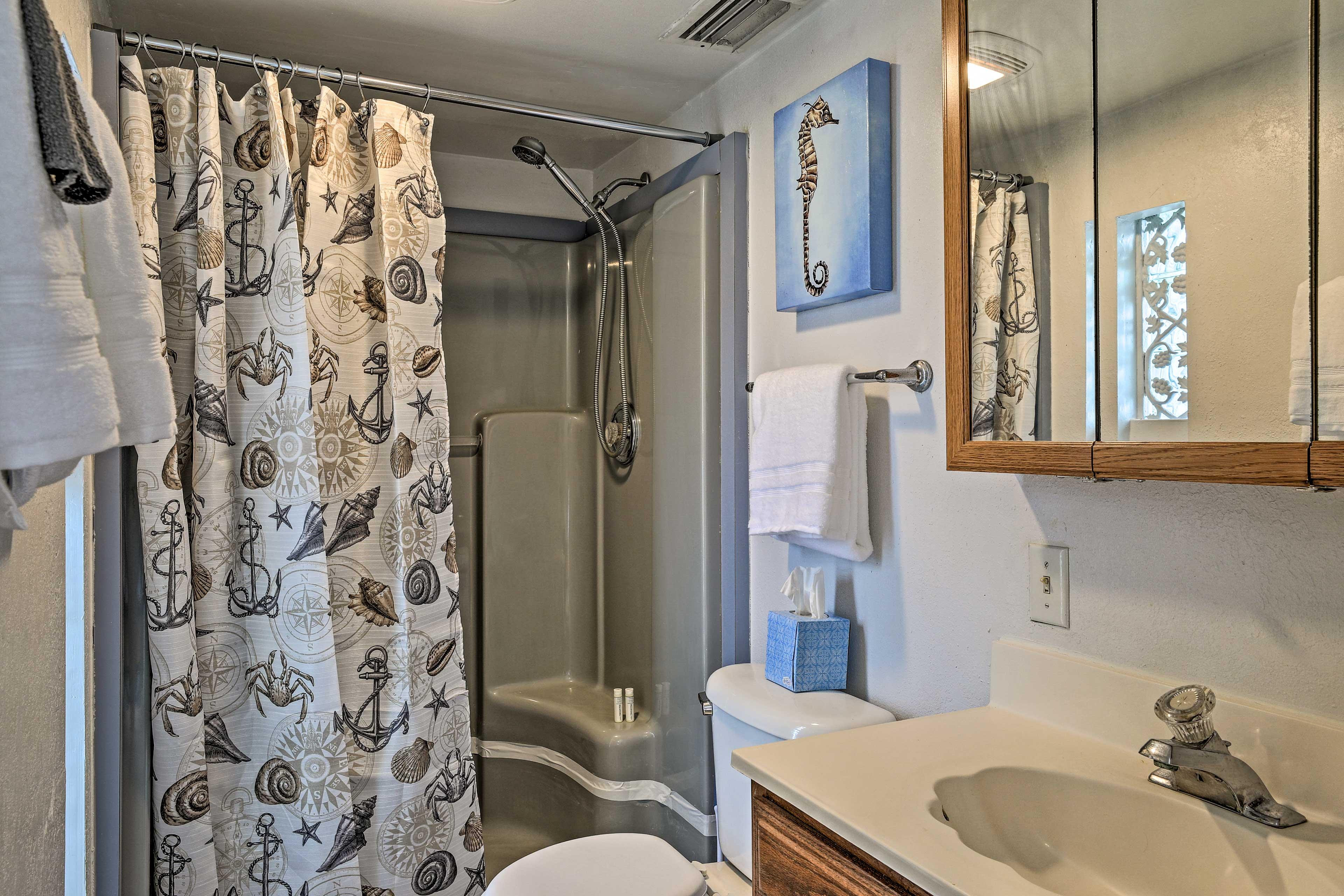 Continue to admire nautical decor in the bathroom.