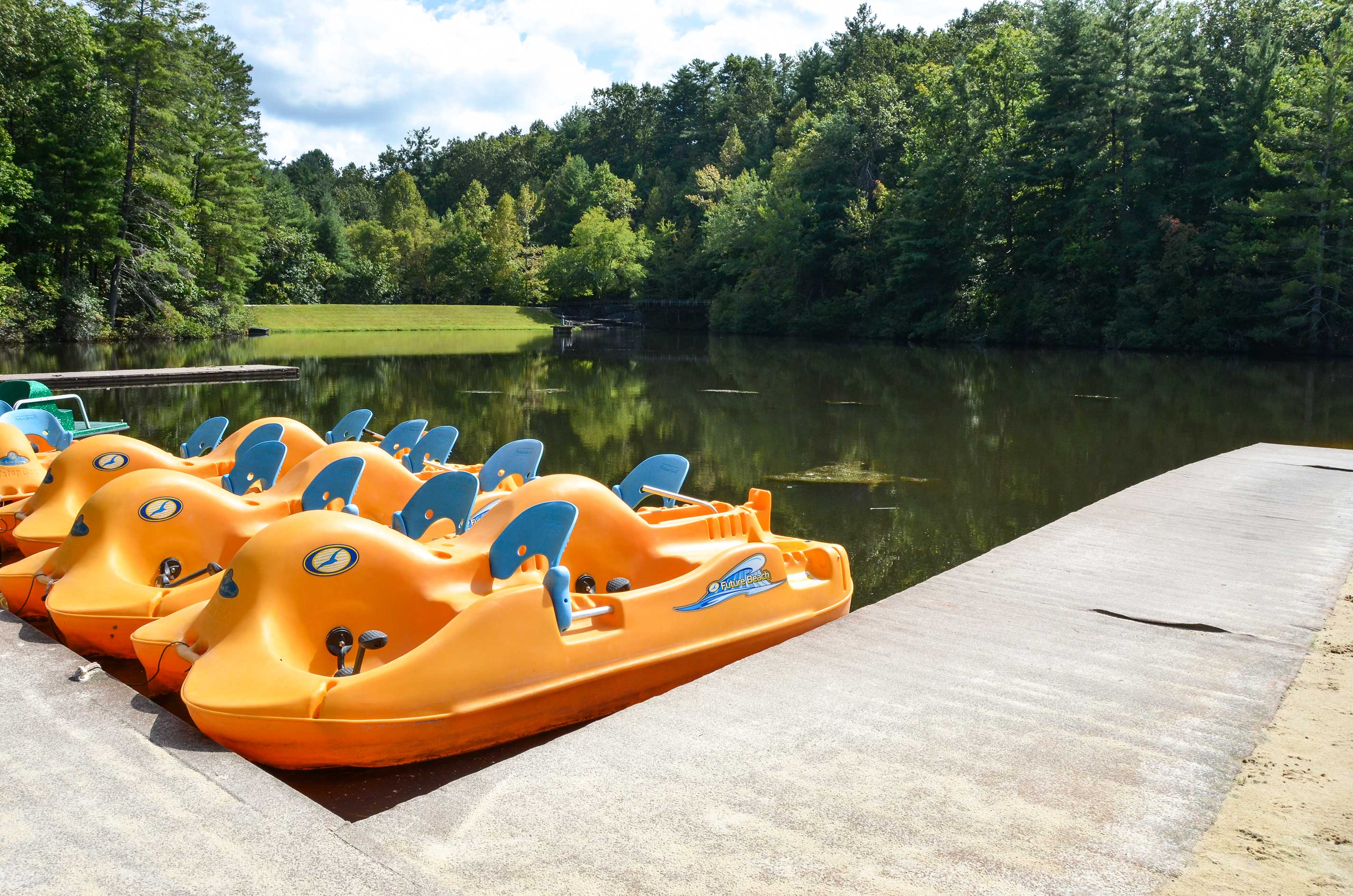 Take a paddle boat out for a spin - just like in summer camp.