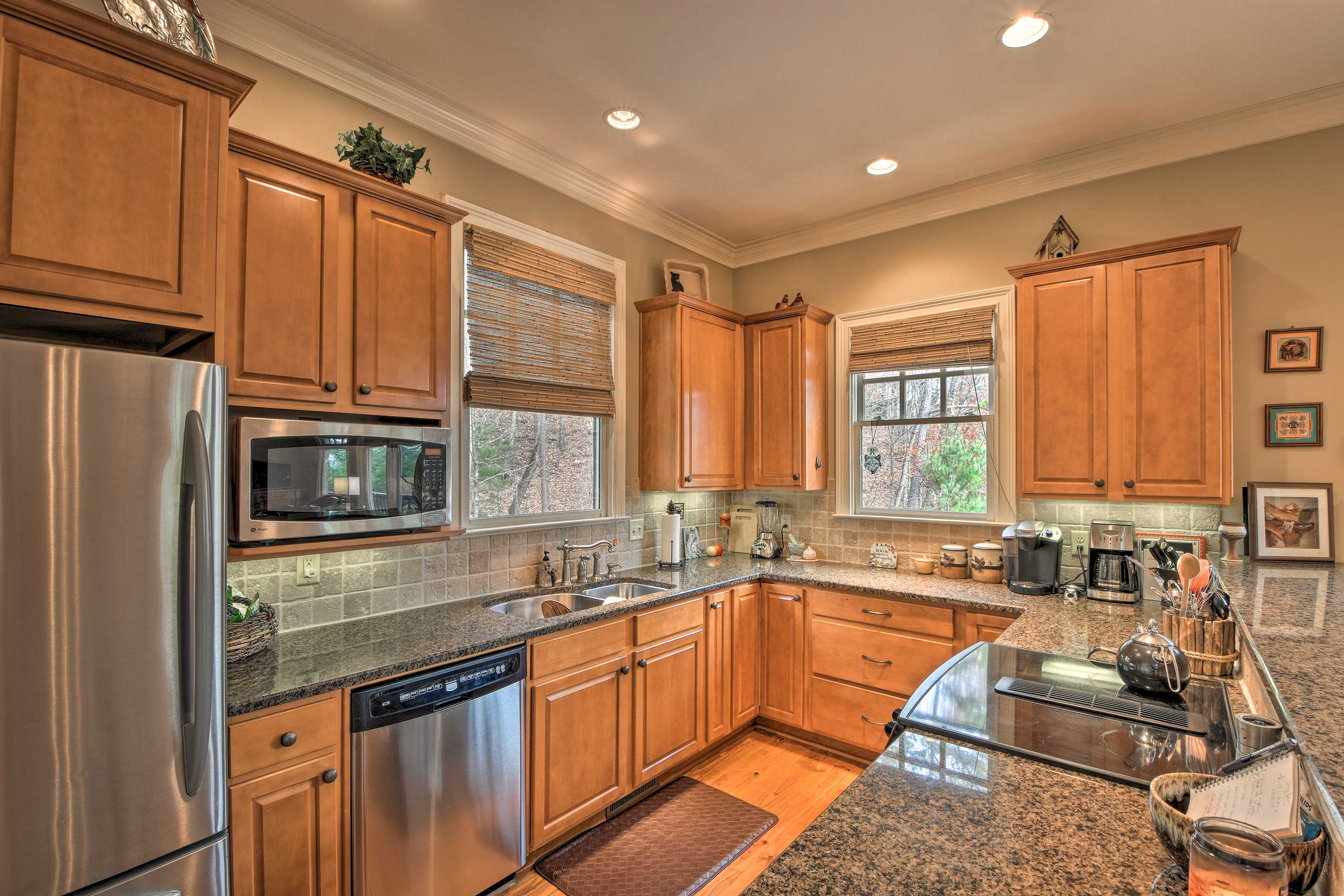 Modern appliances and granite countertops elevate this kitchen.