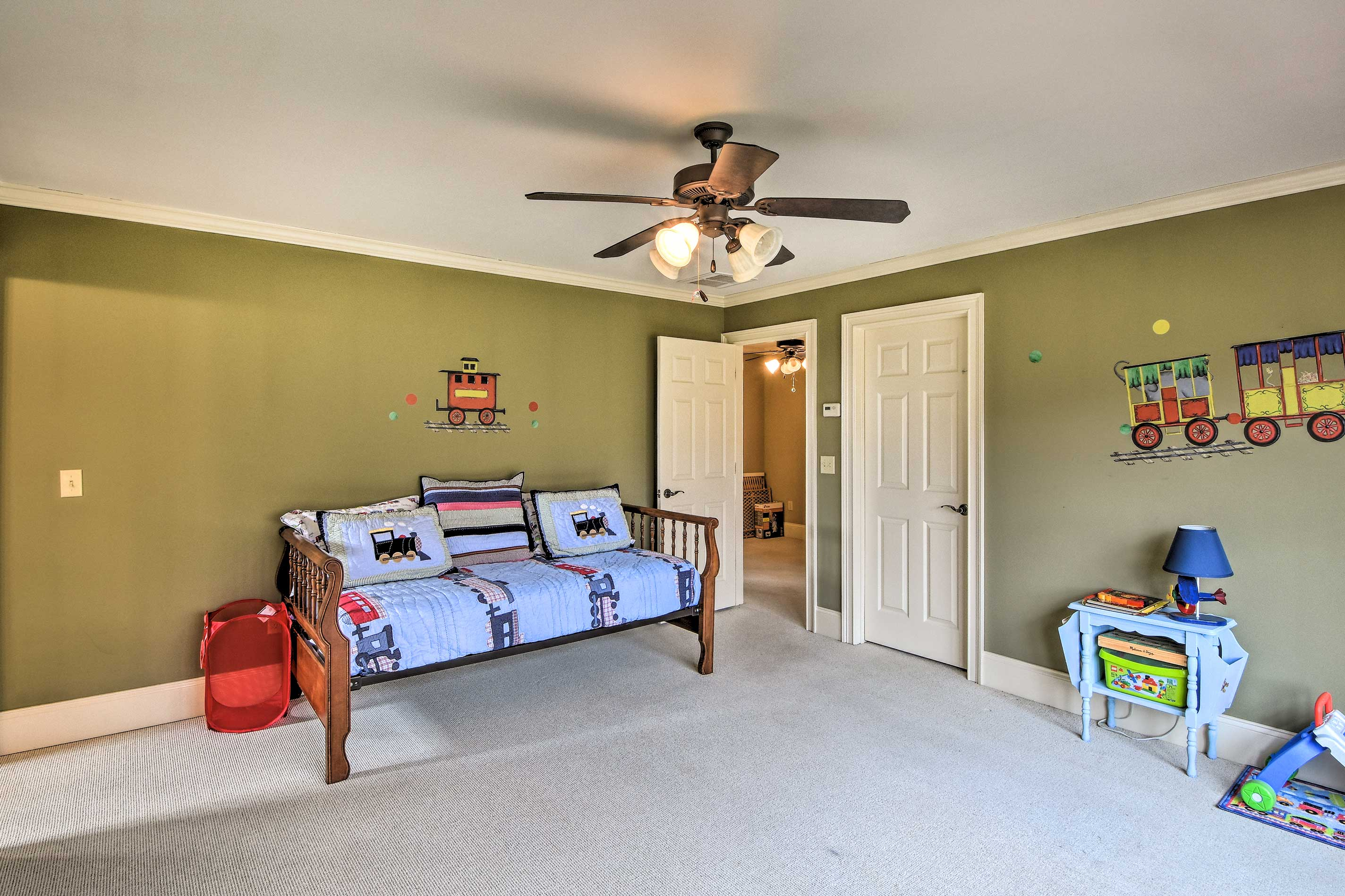 It features a twin bed, plus numerous children's toys.