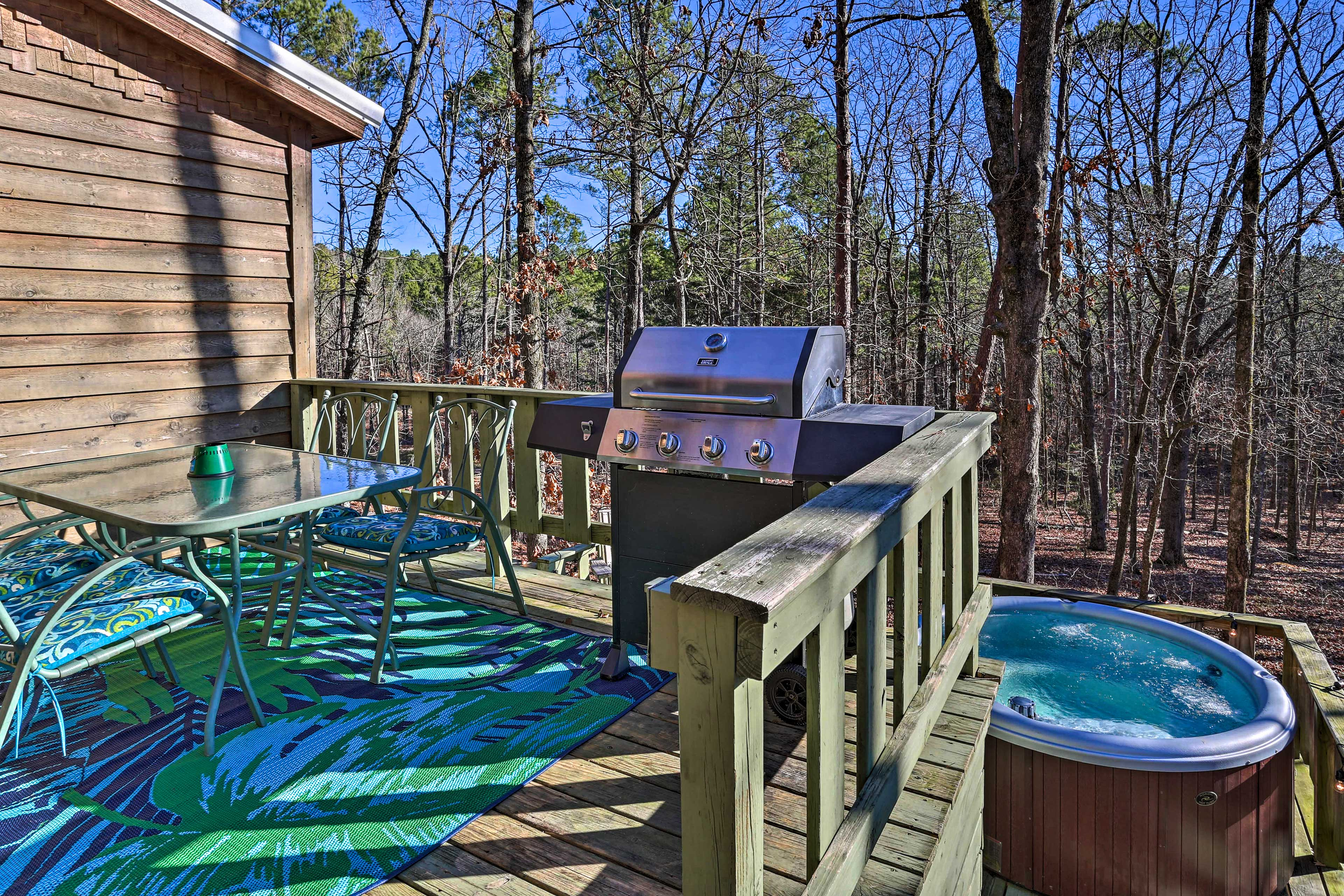 This cozy cabin offers desirable amenities like a hot tub & grill.