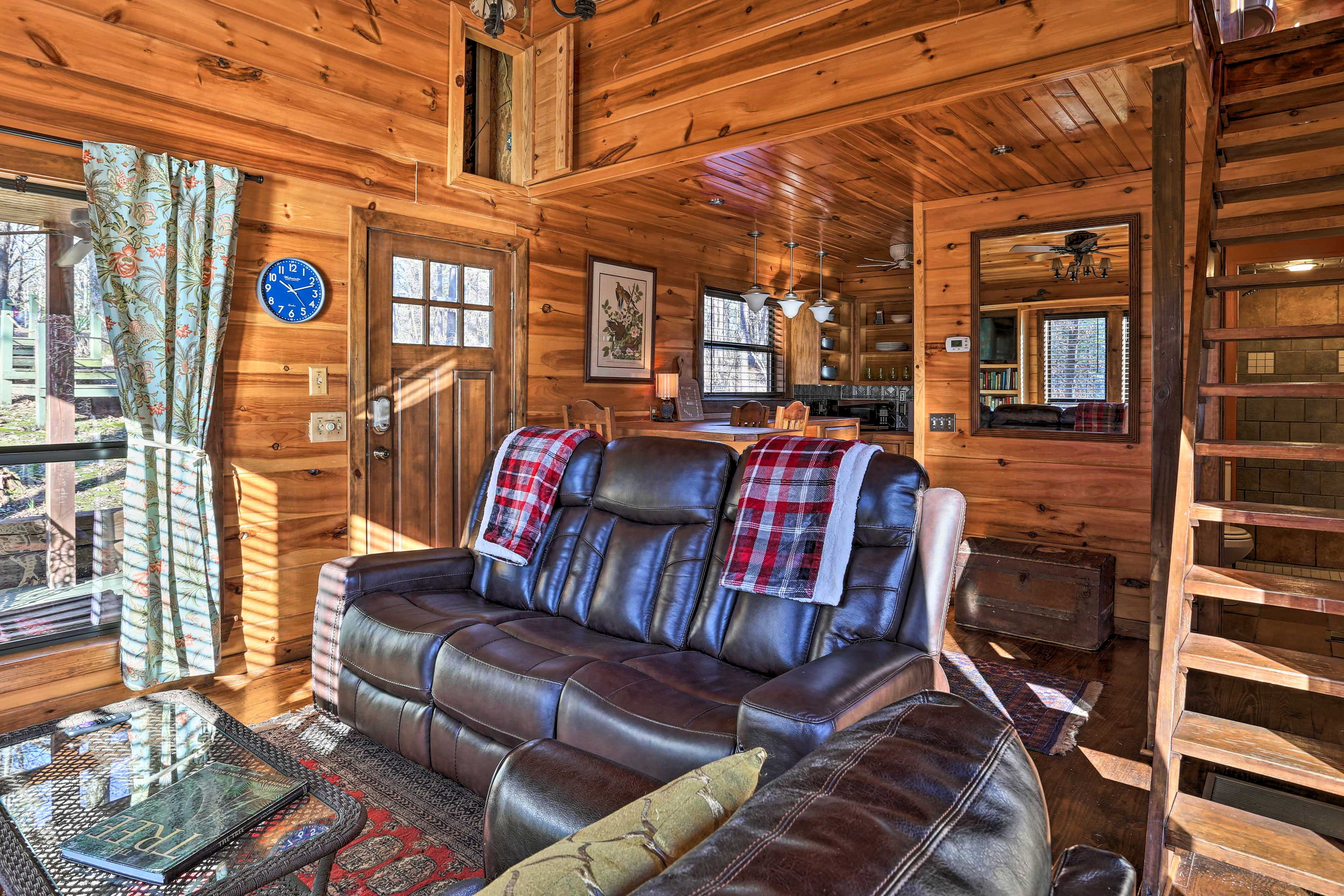 Natural light pours in through this cabin's large windows.