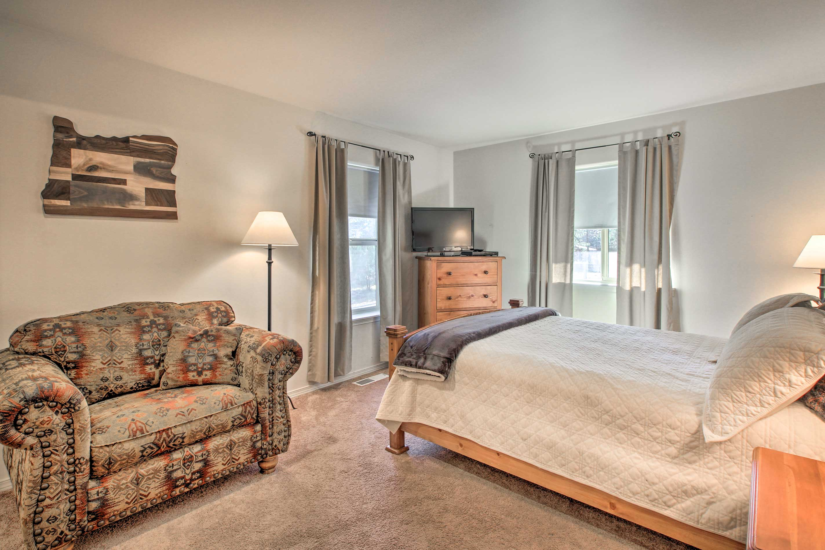 The master bedroom features a queen-sized bed and a flat-screen cable TV.