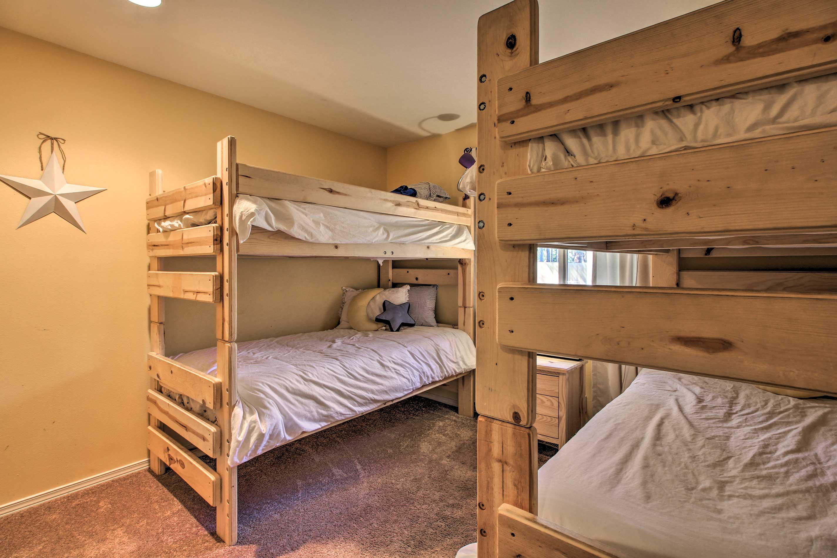 The third bedroom features 2 twin bunk beds.