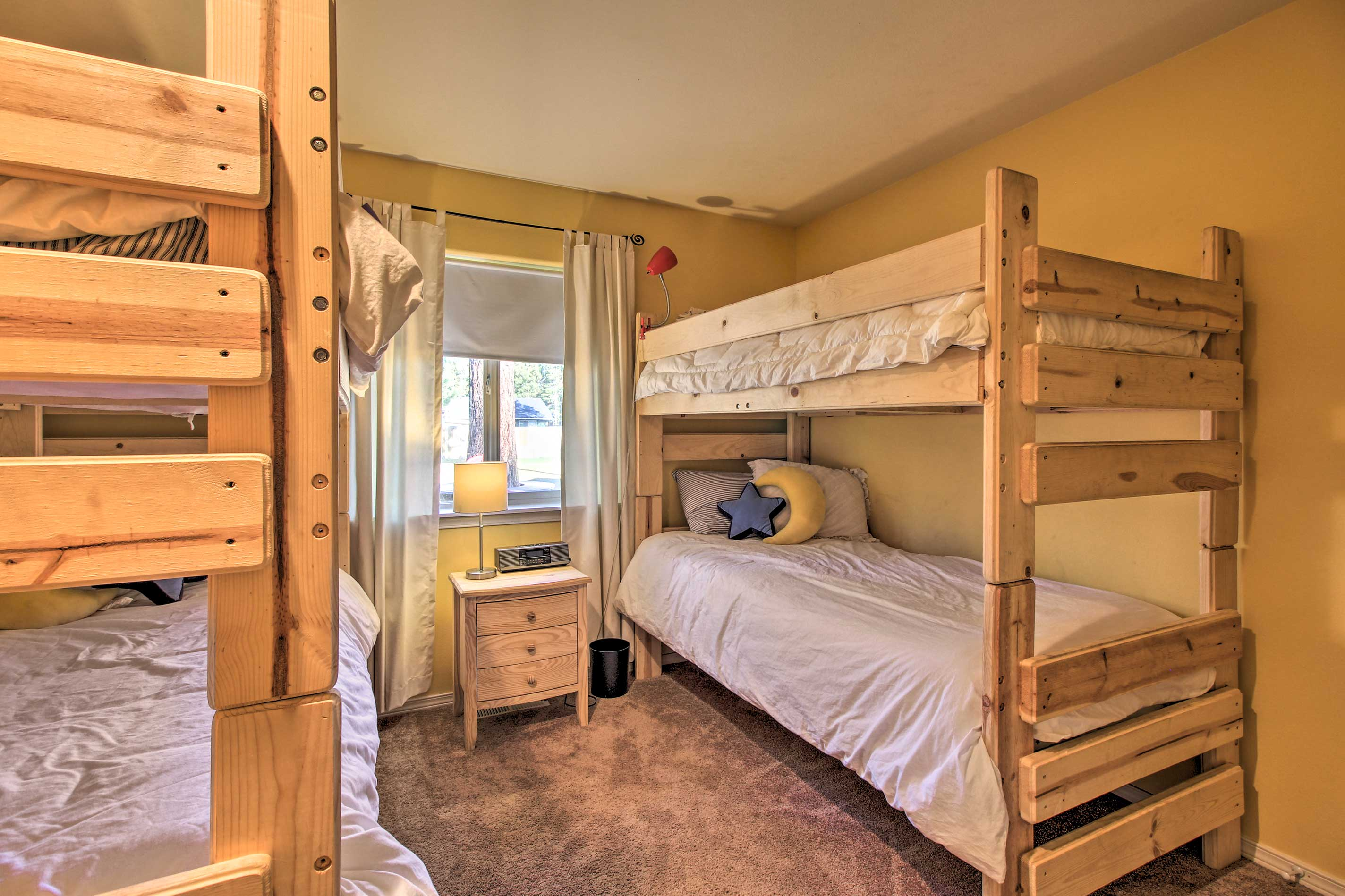 Four kids will love bunking together in this room.
