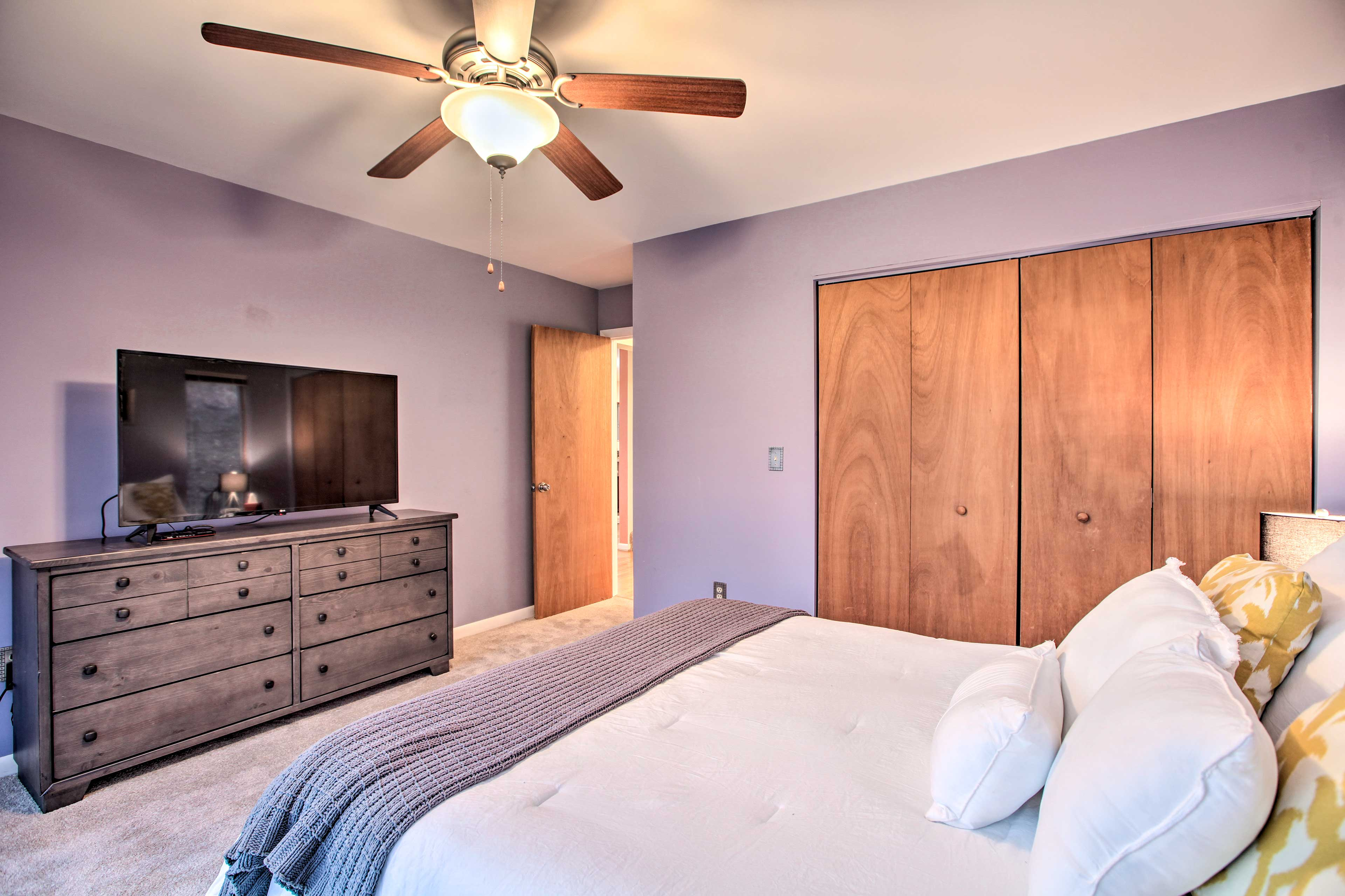 Hunker down for the night in this queen bed.