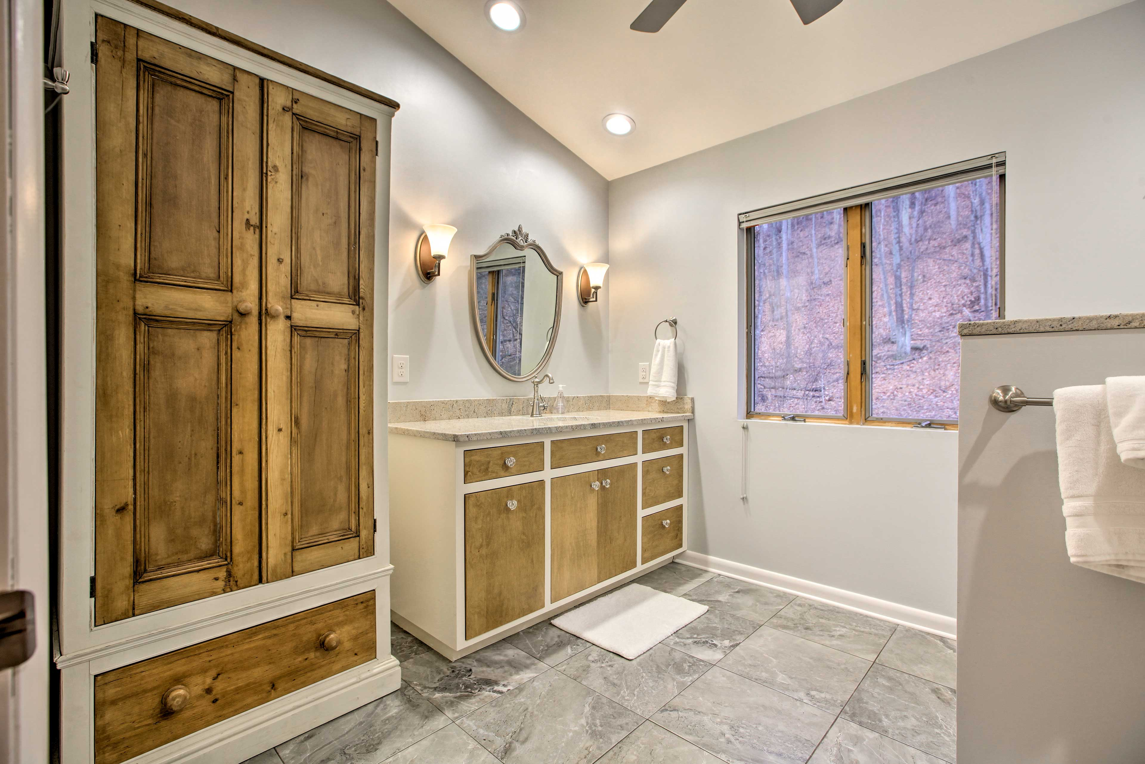 Freshen up in the master bathroom.