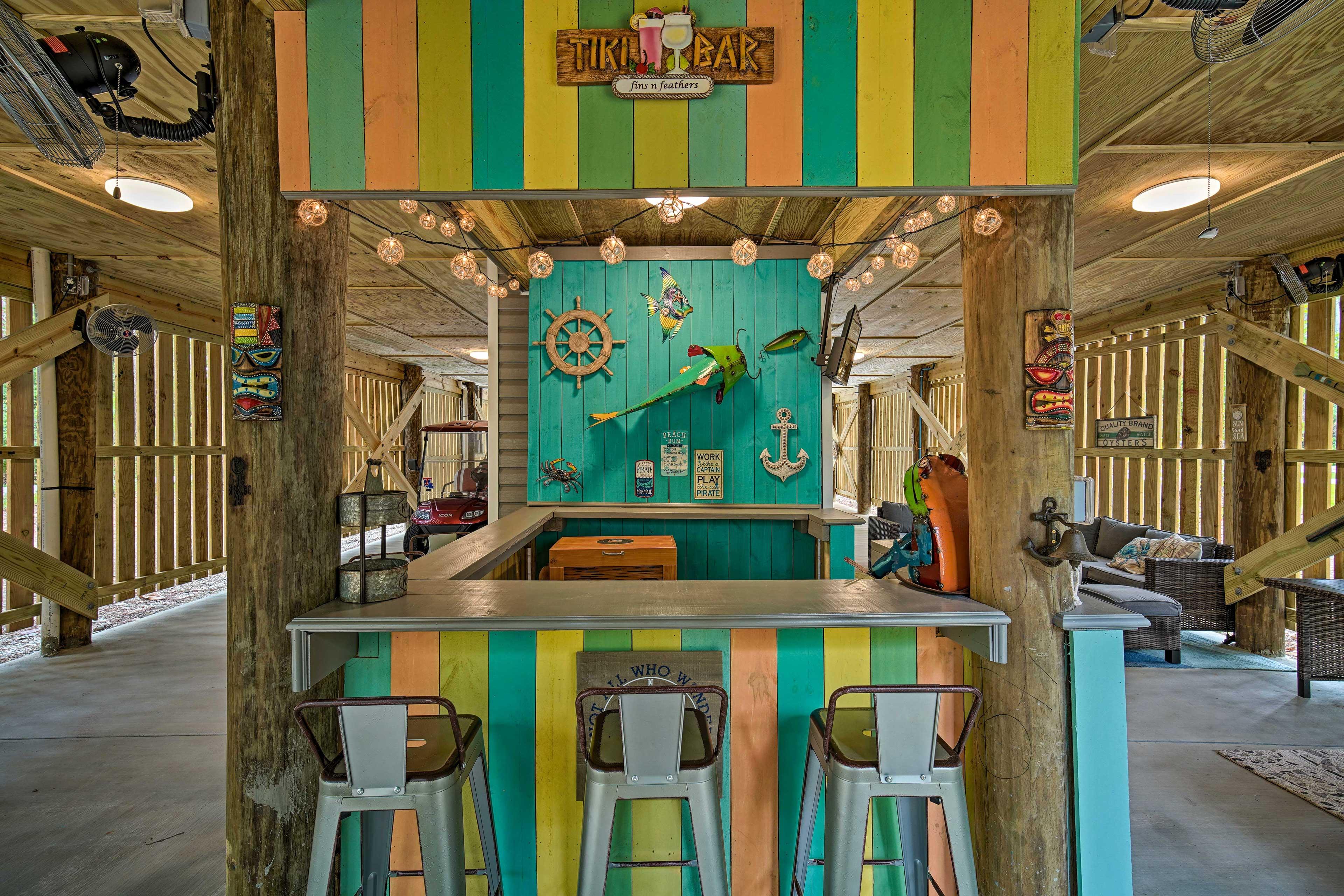 Enjoy tropical alfresco cocktails at the built-in tiki bar.