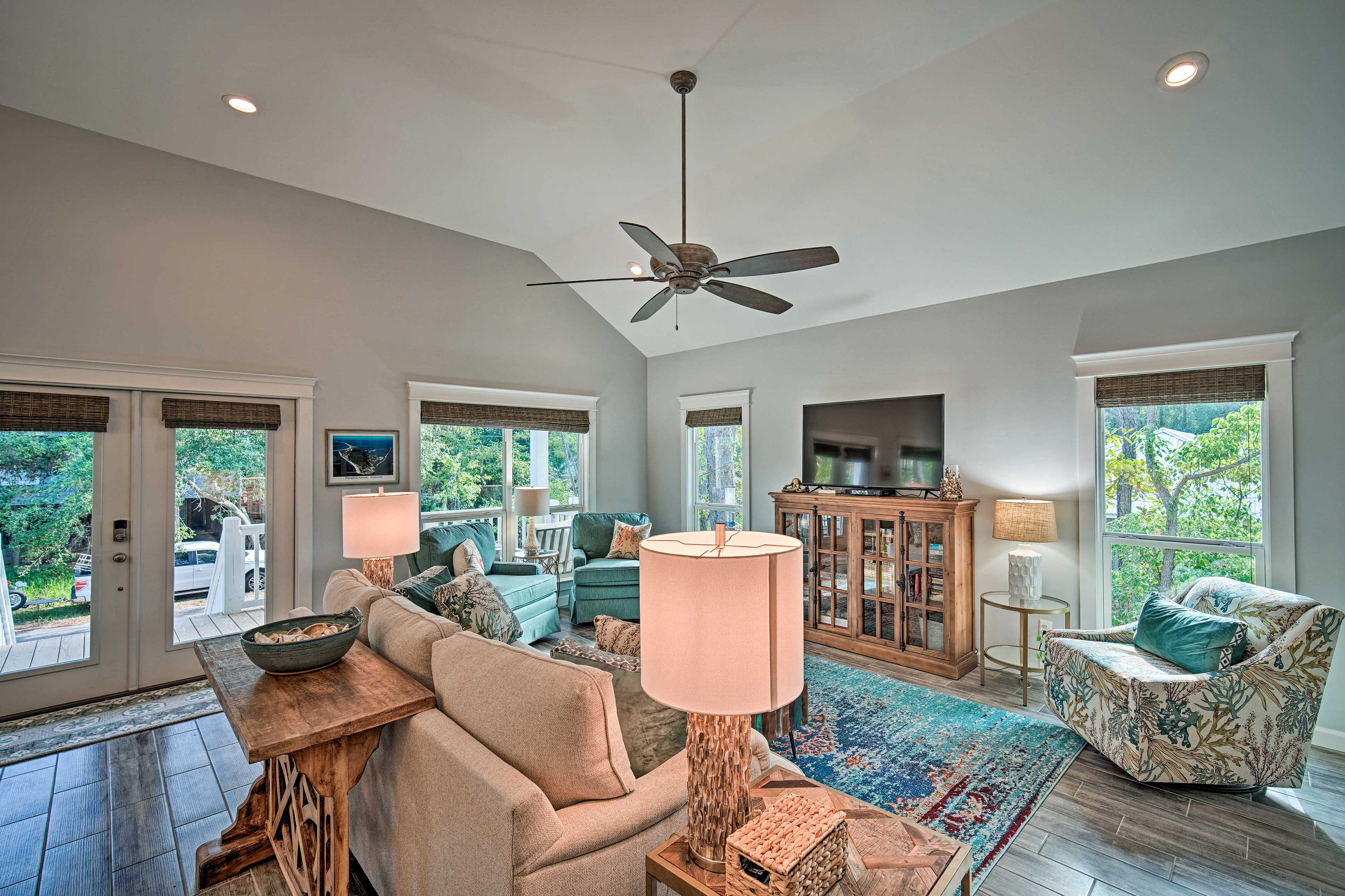 Inside, the living room is highlighted with coastal decor and colorful accents.