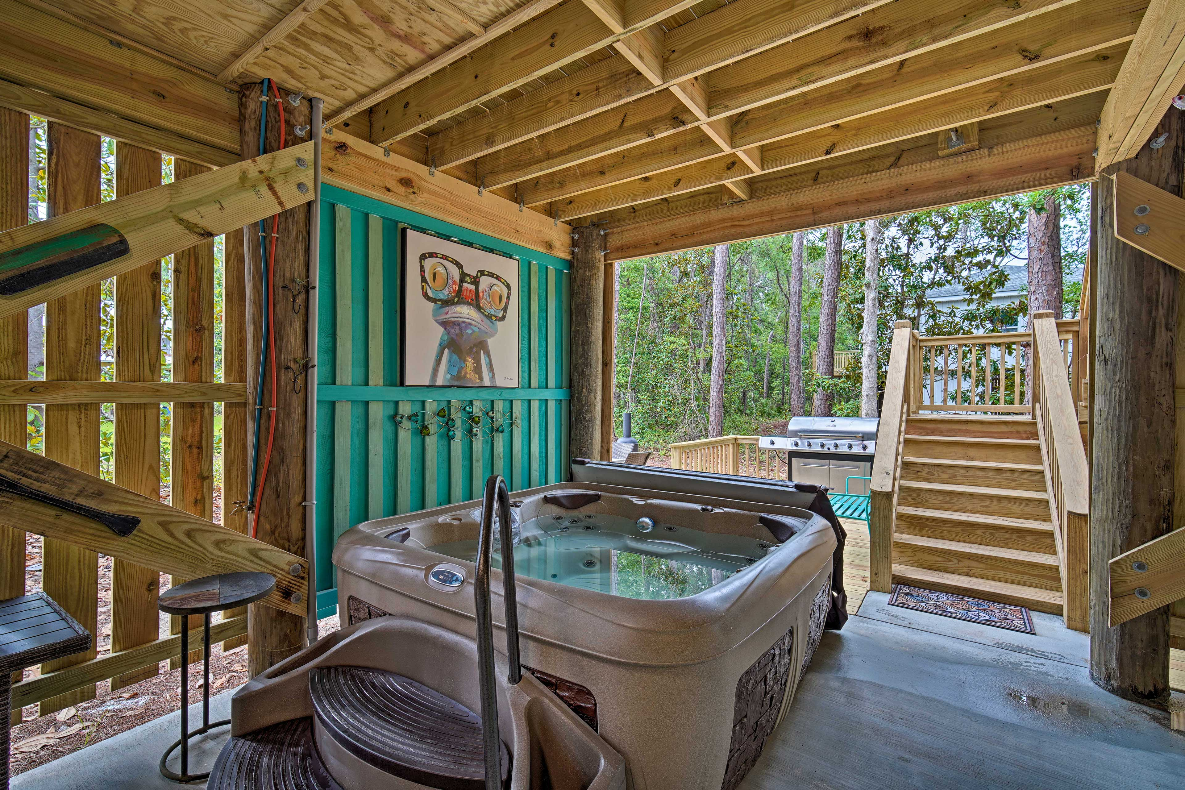The updated property features a private hot tub, deck, and much more!